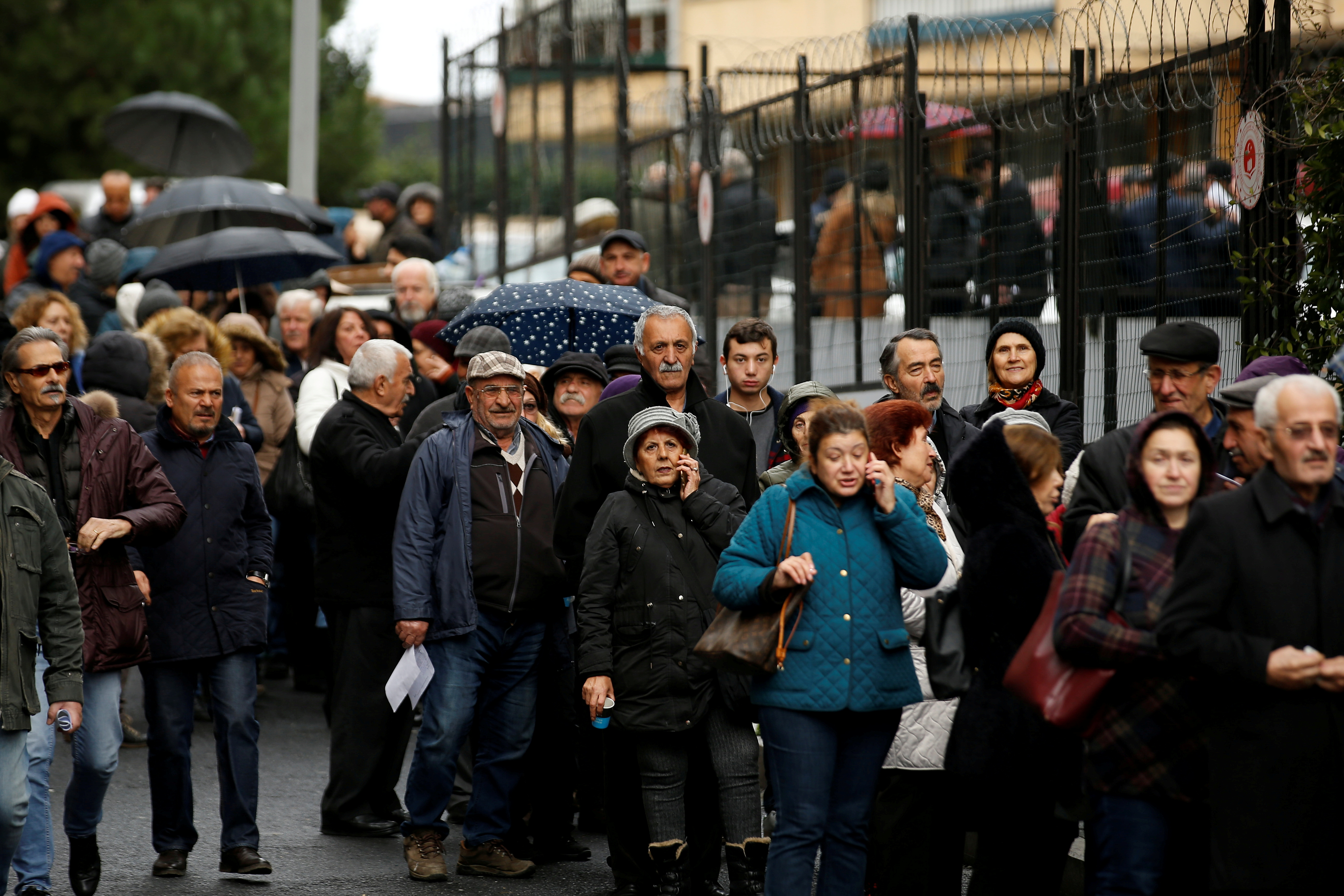 People wait in line to submit their petitions opposing a massive canal project in Istanbul, Turkey, December 27, 2019. REUTERS/Huseyin Aldemir/File Photo