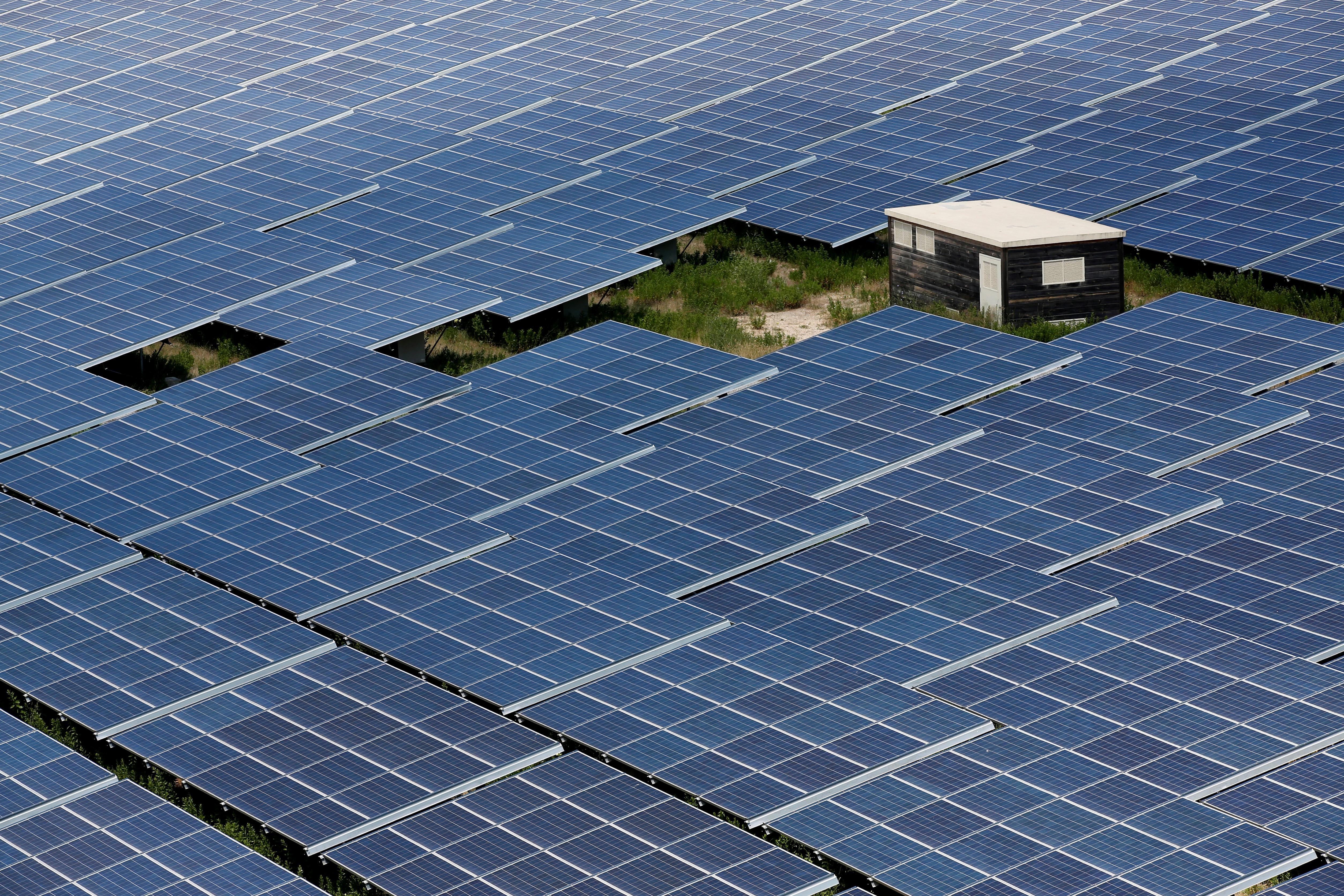 Solar panels to produce renewable energy are seen at the Urbasolar photovoltaic park in Gardanne, France, June 25, 2018.    REUTERS/Jean-Paul Pelissier