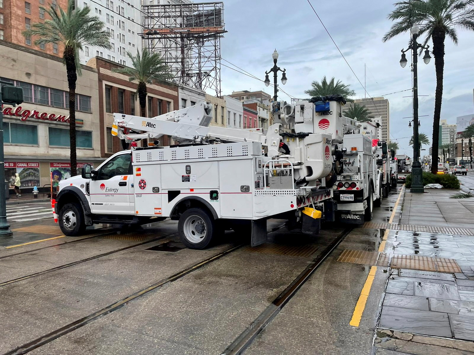 Energy power crews work to restore power after Hurricane Ida struck New Orleans, Louisiana, U.S., August 30, 2021. REUTERS/Devika Krishna Kumar