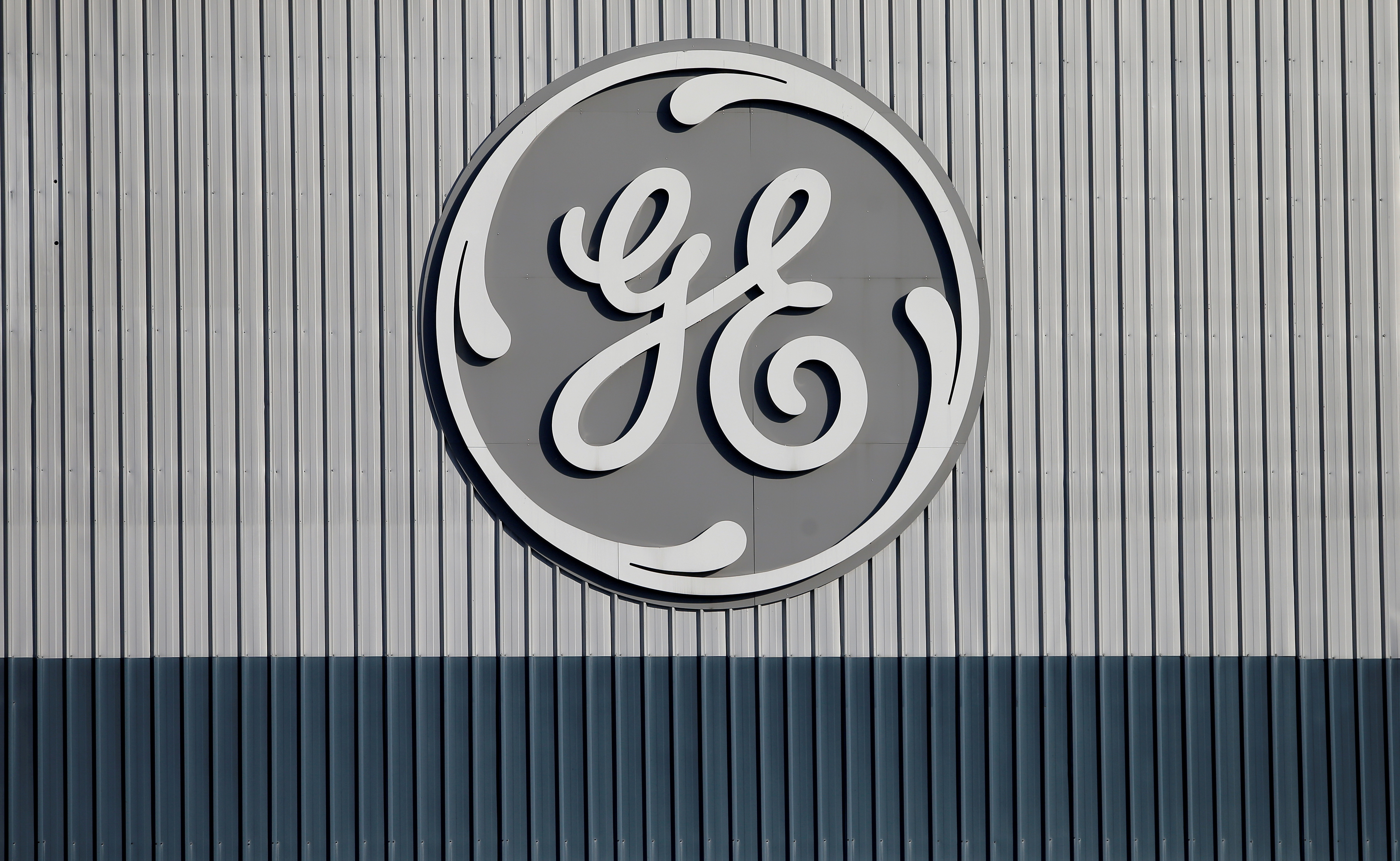 The logo of U.S. conglomerate General Electric is pictured at the site of the company's energy branch in Belfort, France, February 5, 2019. REUTERS/Vincent Kessler/File Photo
