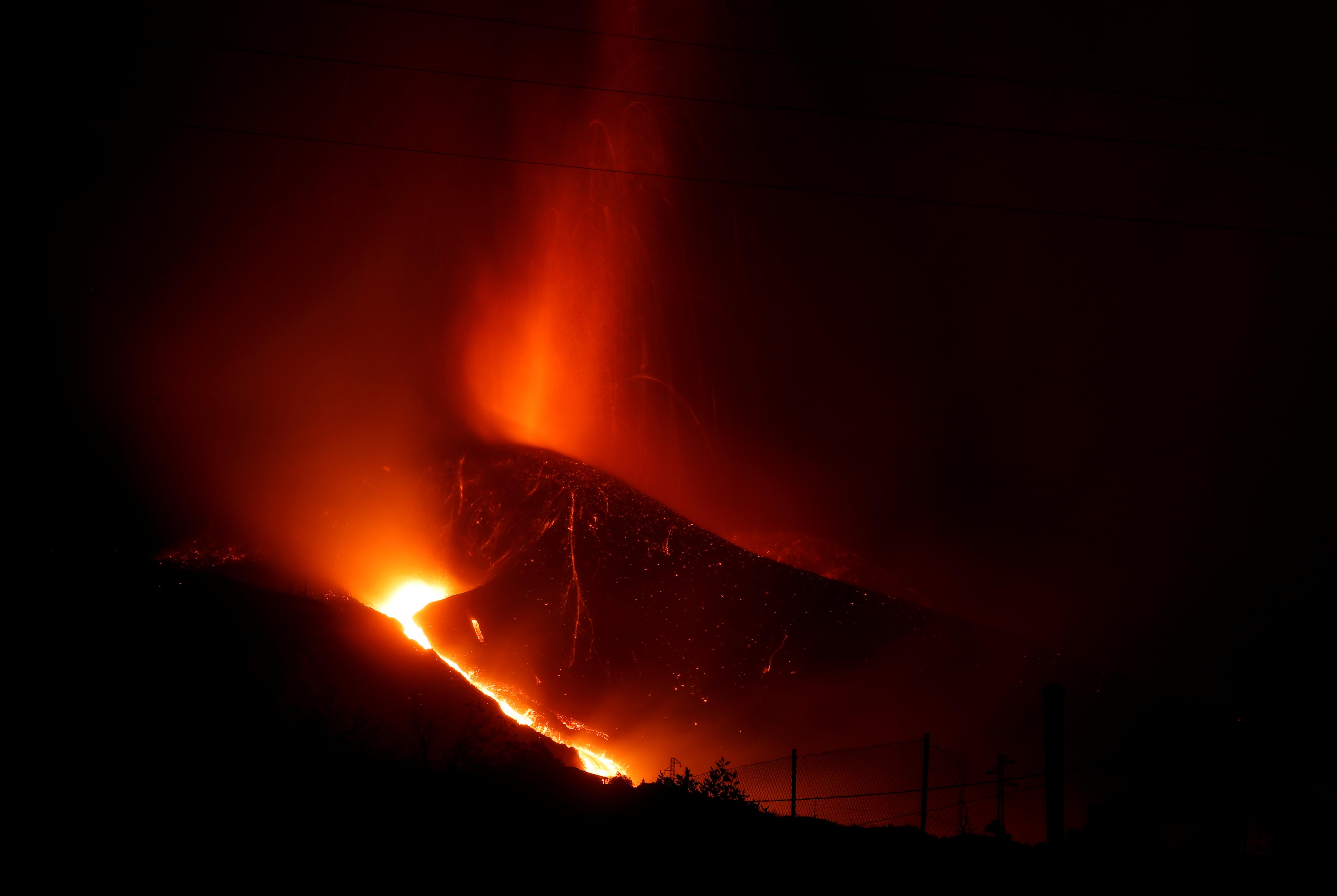 Lava and smoke rise following the eruption of a volcano on the Canary Island of La Palma, in La Laguna, Spain, September 24, 2021. REUTERS/Jon Nazca