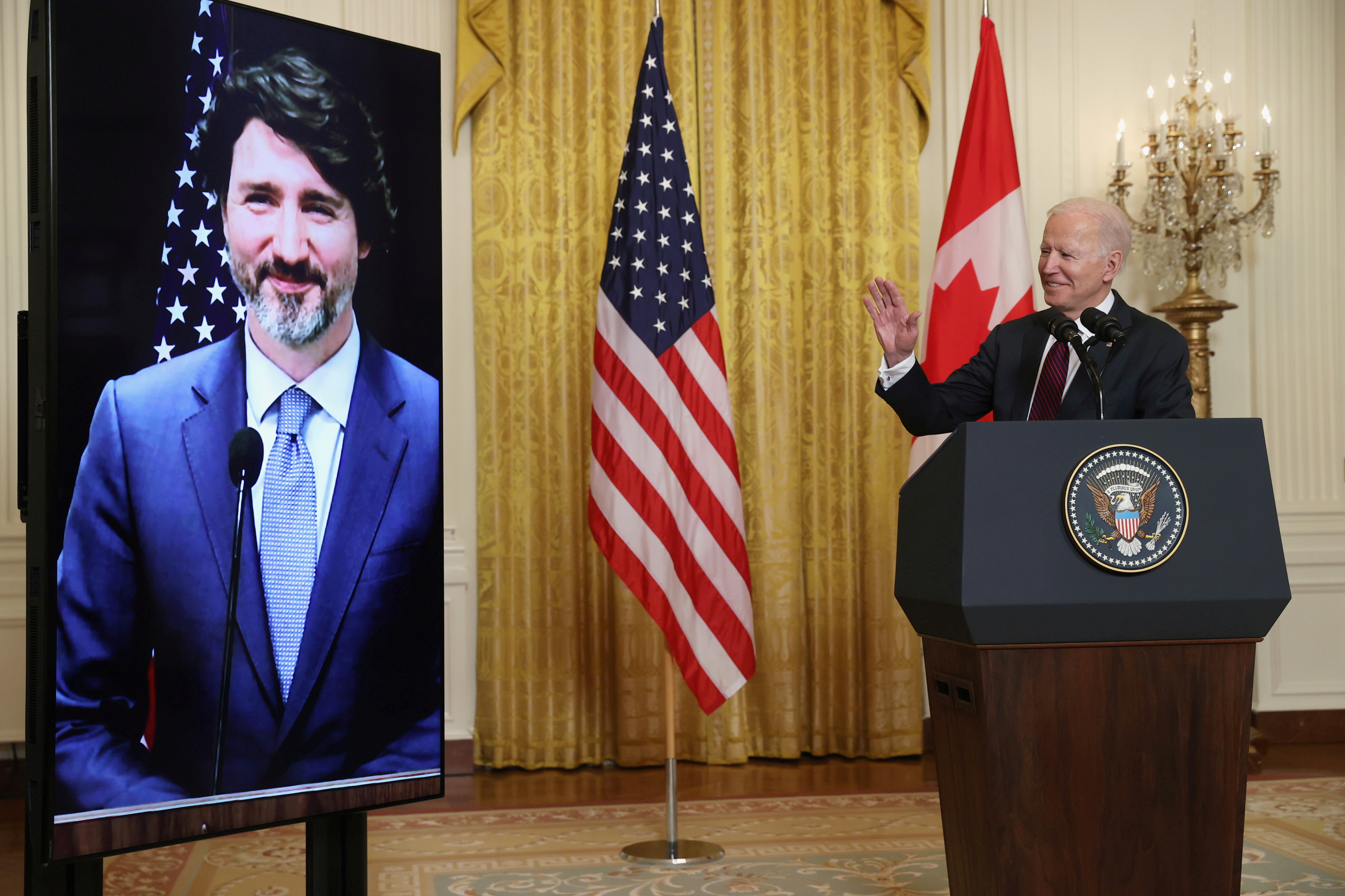 U.S. President Joe Biden gestures to Canada's Prime Minister Justin Trudeau, appearing via video conference call, during closing remarks at the end of their virtual bilateral meeting from the White House in Washington, U.S. February 23, 2021. REUTERS/Jonathan Ernst/File Photo