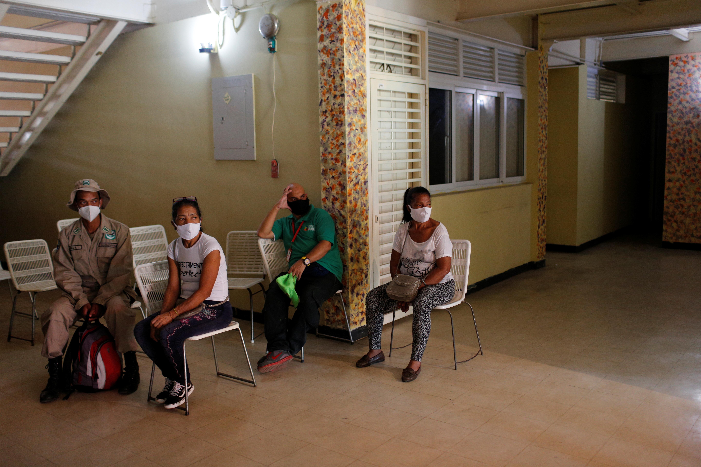 People wait to receive a dose of Cuba's Abdala vaccine at a vaccination center in Caracas, Venezuela July 1, 2021. REUTERS/Manaure Quintero