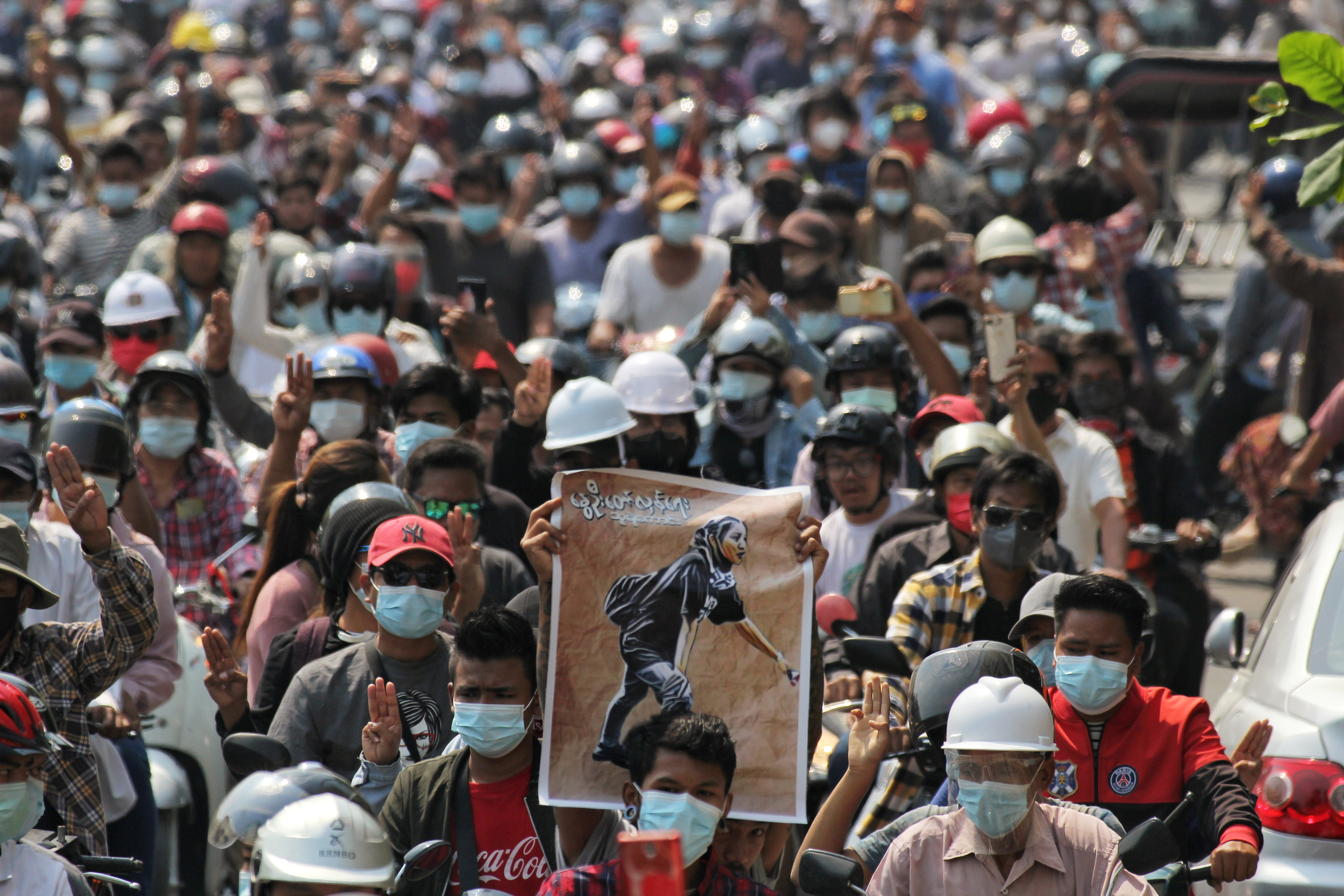 People attend the funeral of Angel a 19-year-old protester also known as Kyal Sin who was shot in the head as Myanmar forces opened fire  to disperse an anti-coup demonstration in Mandalay, Myanmar, March 4, 2021. REUTERS/Stringer