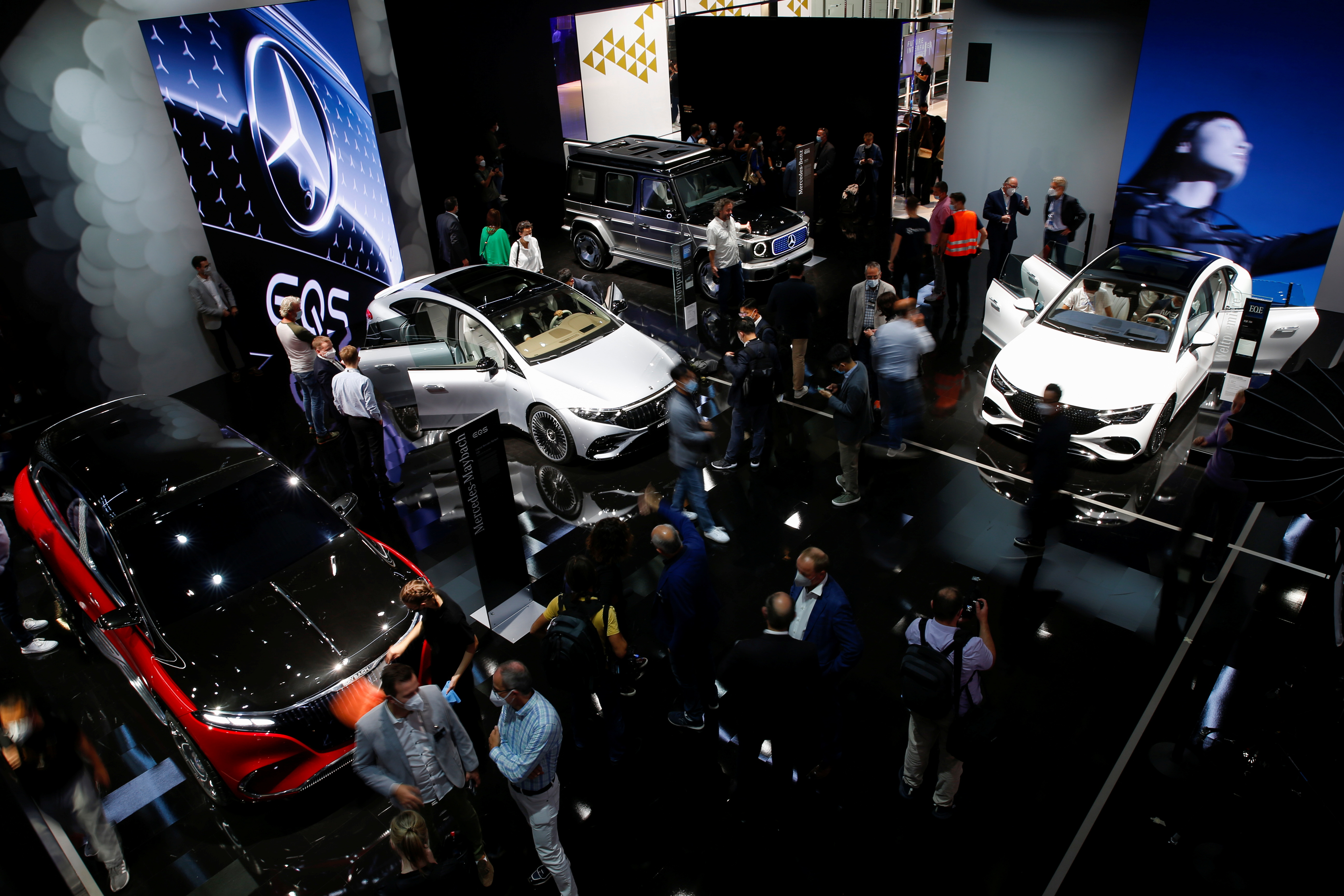 Visitors stand at Mercedes booth ahead of the Munich Motor Show IAA Mobility 2021 in Munich, Germany, September 6, 2021. REUTERS/Michaela Rehle