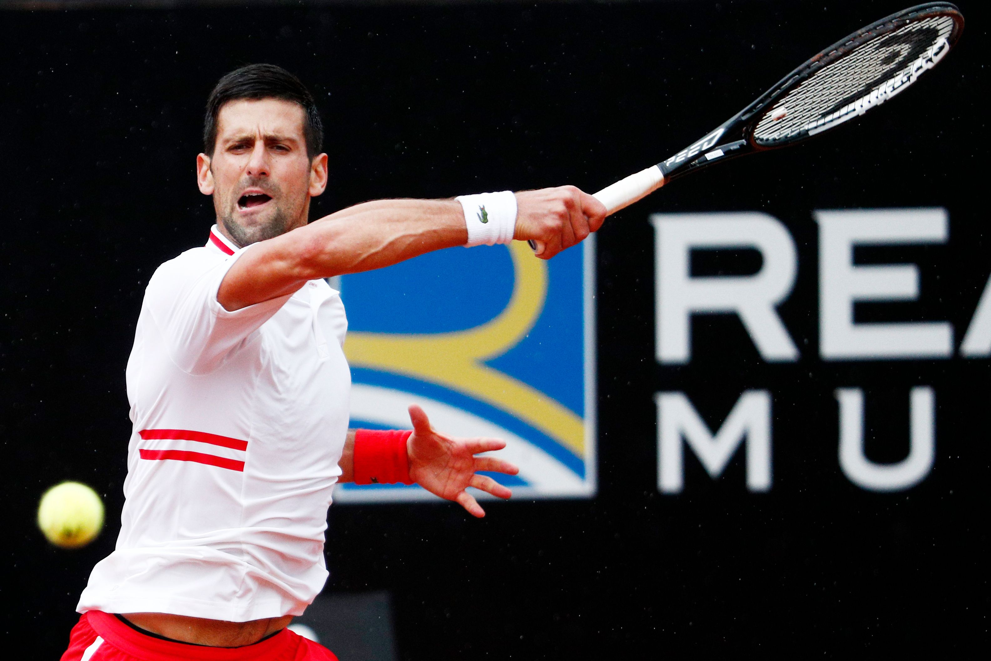 Tennis - ATP Masters 1000 - Italian Open - Foro Italico, Rome, Italy - May 11, 2021 Serbia's Novak Djokovic in action during his second round match against Taylor Fritz of the U.S. REUTERS/Guglielmo Mangiapane