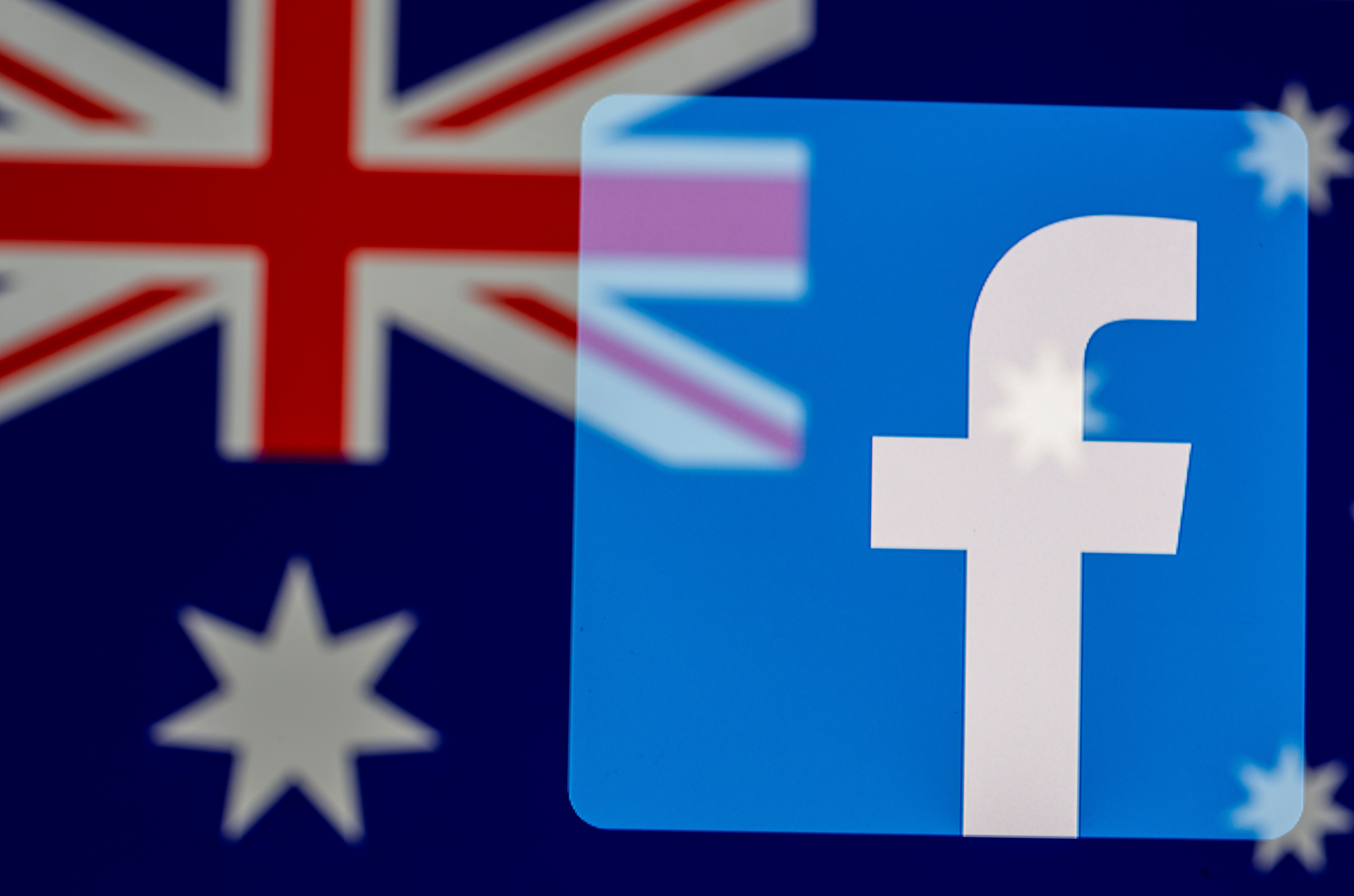 Facebook logo and Australian flag are displayed in this illustration taken, February 18, 2021. REUTERS/Dado Ruvic/Illustration/File Photo