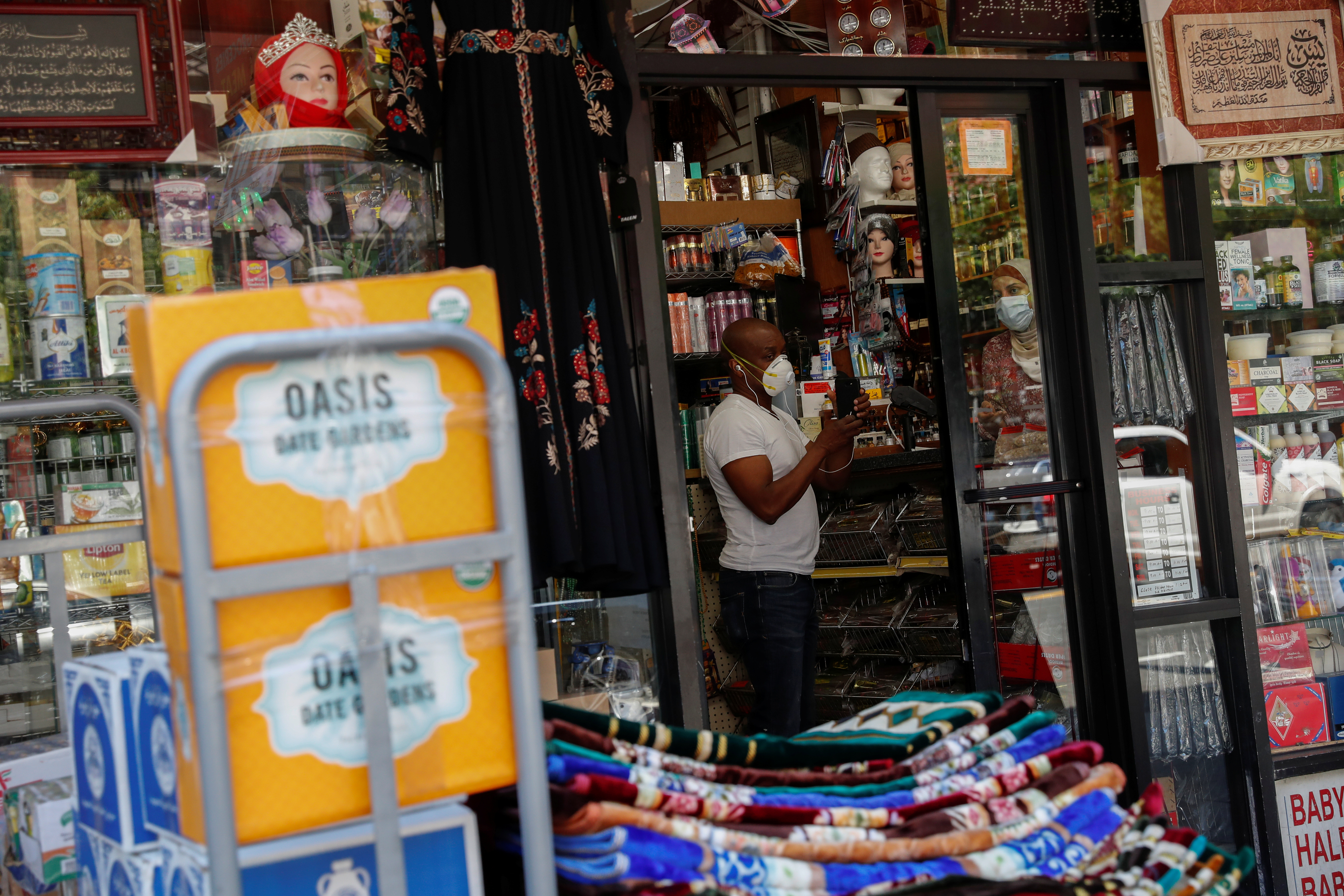 A shopkeeper works inside his retail store as the phase one reopening of New York City continues during the outbreak of the coronavirus disease (COVID-19) in the Brooklyn borough of New York City, New York, U.S. June 9, 2020. REUTERS/Shannon Stapleton