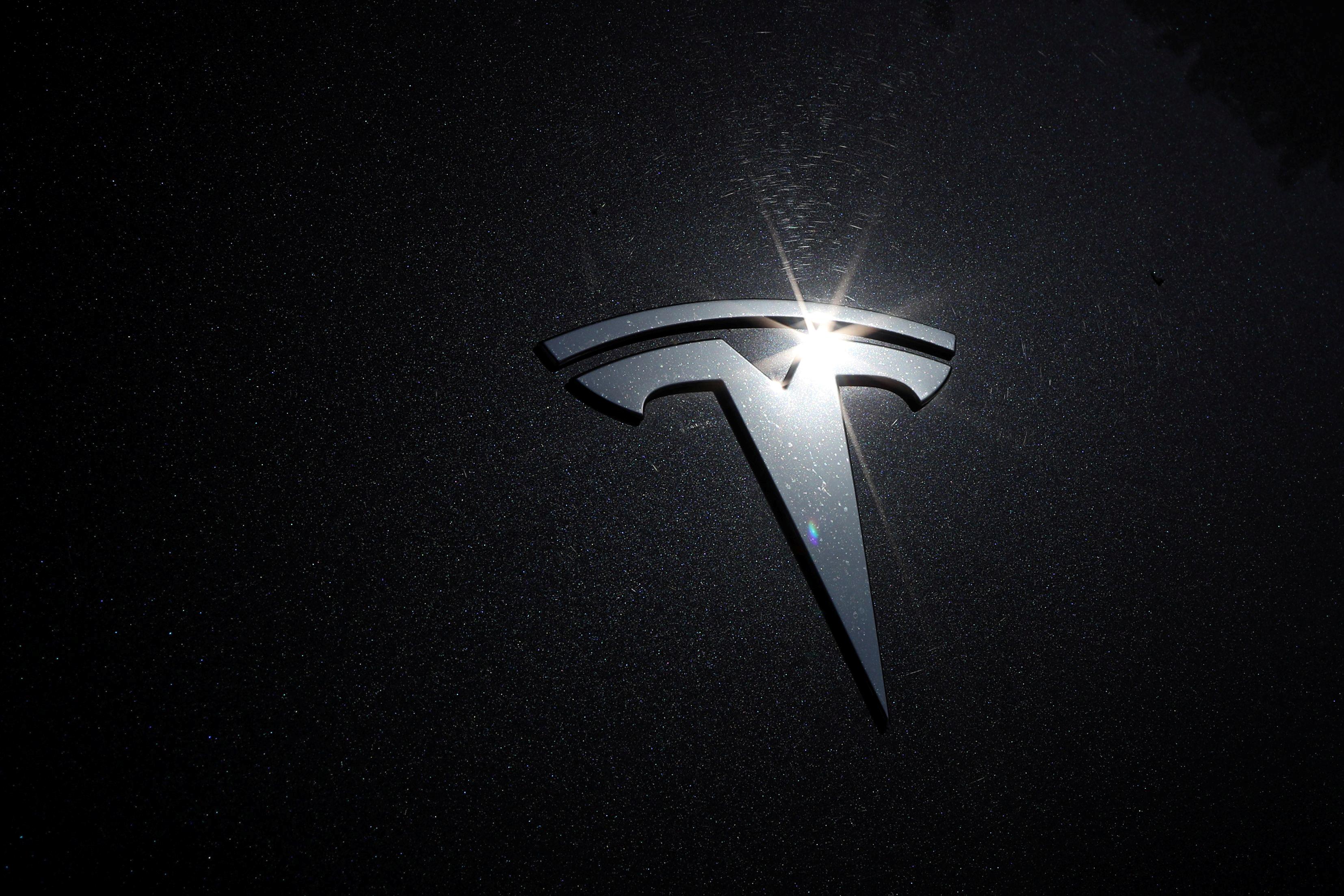 The Tesla logo is seen on a car in Los Angeles, California, U.S., July 9, 2020.  REUTERS/Lucy Nicholson