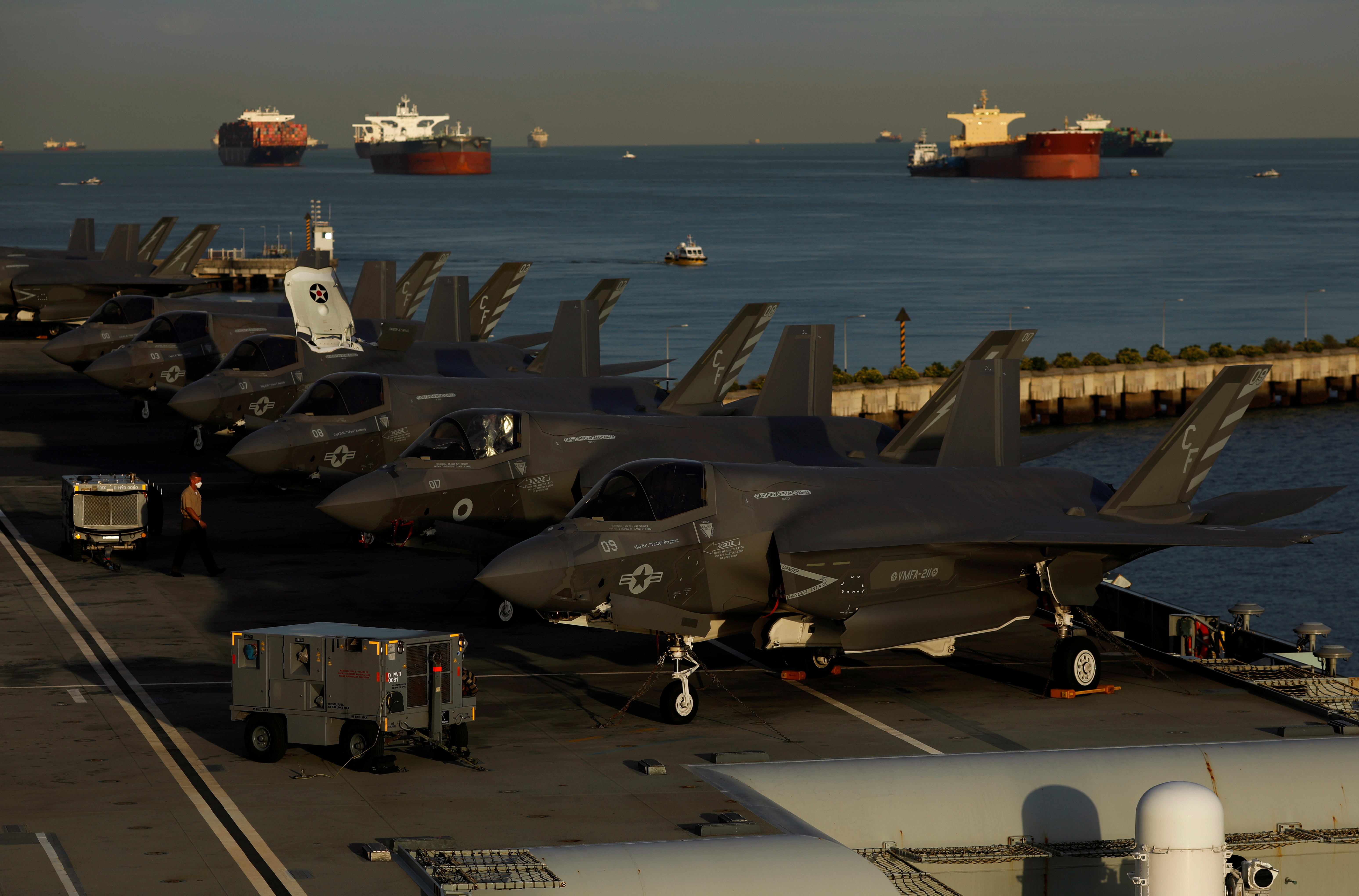 A row of Lockheed Martin F-35B Lightning II aircraft is seen onboard Britain's HMS Queen Elizabeth aircraft carrier at Changi Naval Base in Singapore October 11, 2021. REUTERS/Edgar Su