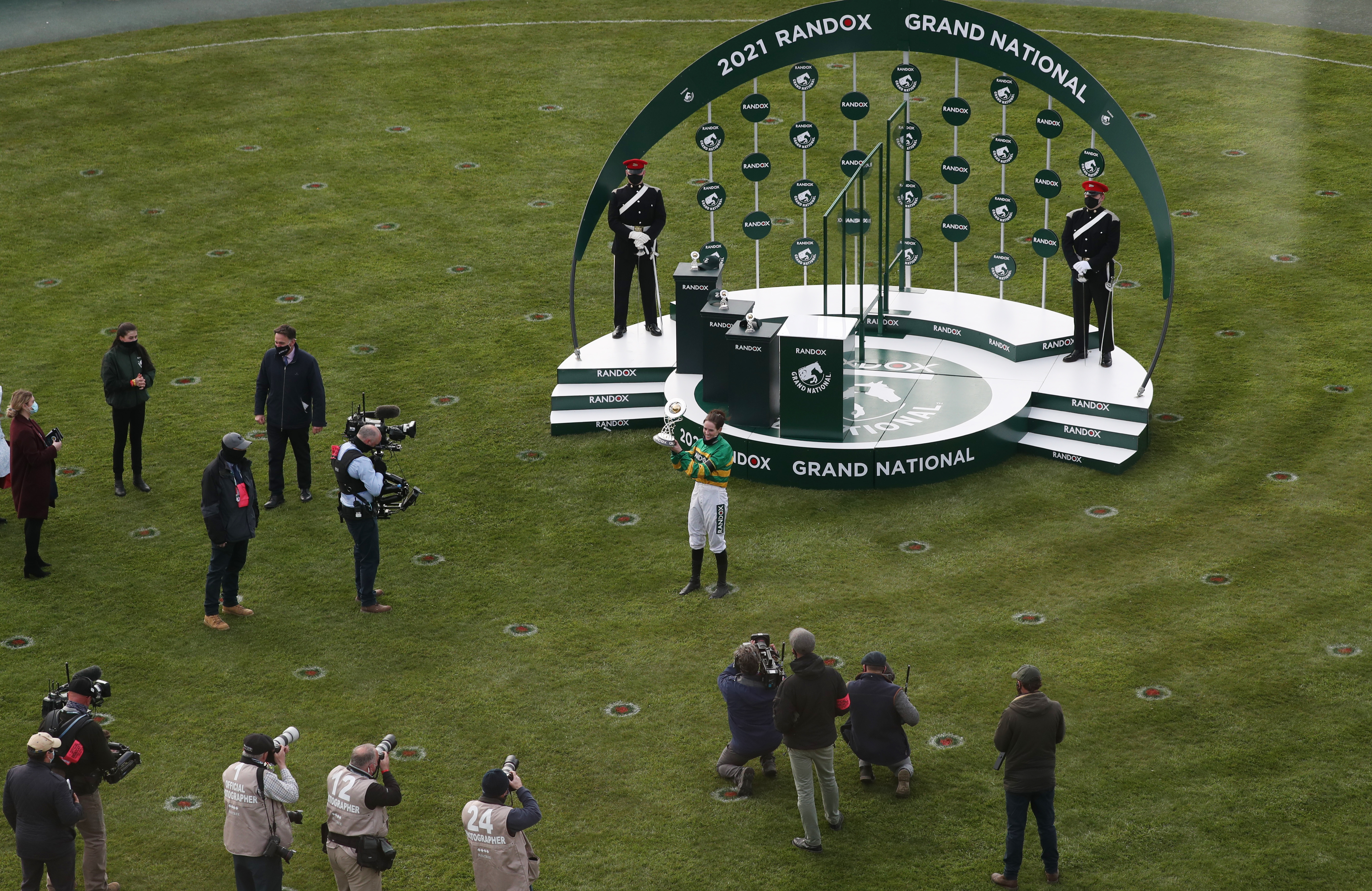 Horse Racing - Grand National Festival - Aintree Racecourse, Liverpool, Britain - April 10, 2021 Jockey Rachael Blackmore celebrates with the trophy after winning the Grand National riding Minella Times Pool via REUTERS/Scott Heppell