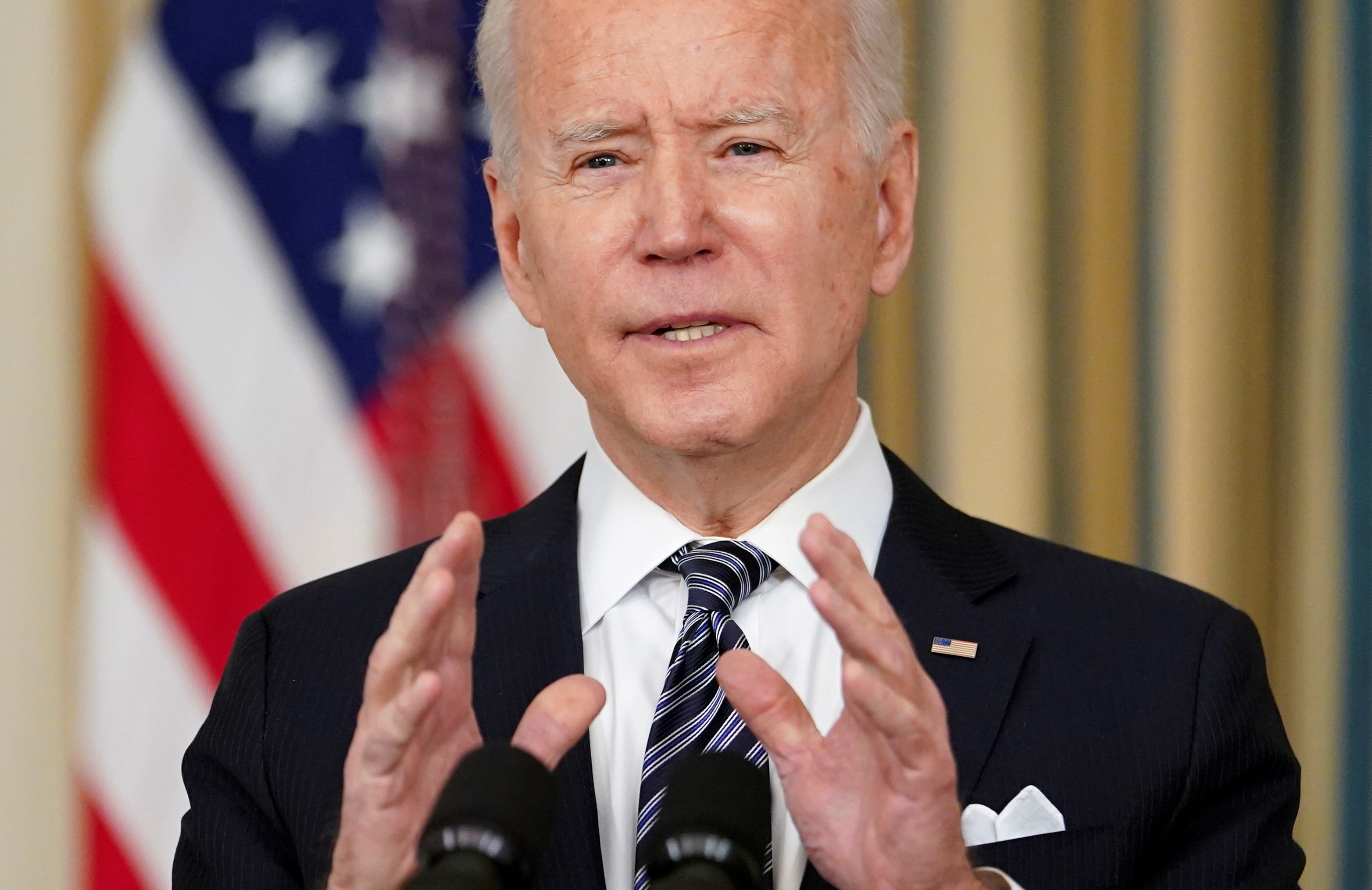 U.S. President Joe Biden speaks about the implementation of the American Rescue Plan in the State Dining Room at the White House in Washington, U.S., March 15, 2021. REUTERS/Kevin Lamarque/