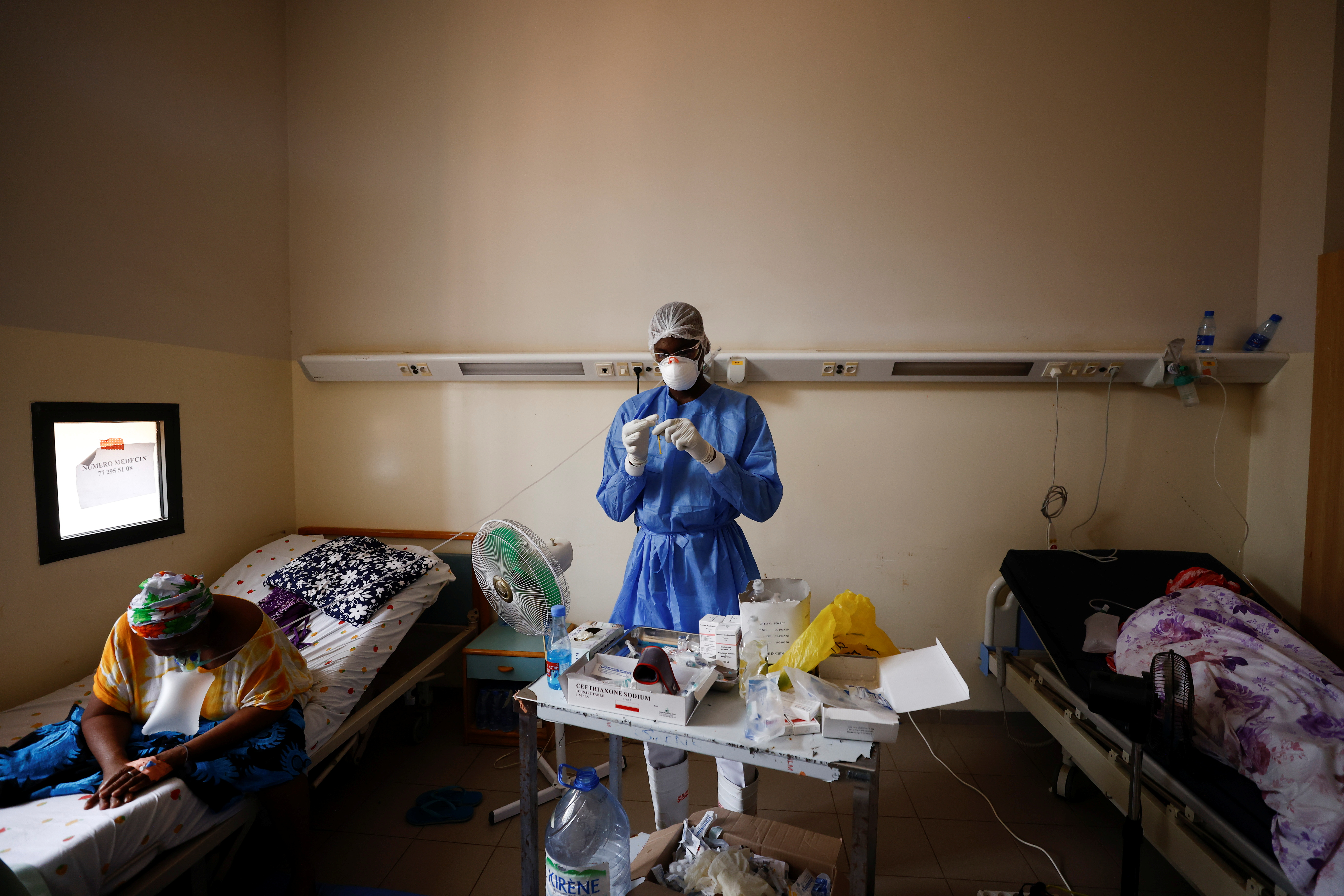 Nurse Ibrahima Toumane (29) prepares to treat patients who are suffering from the coronavirus disease (COVID-19), in the infectious diseases department of Dalal Jamm hospital, as Senegal records more COVID-19 deaths, Dakar, Senegal, August 5, 2021.  REUTERS/Zohra Bensemra