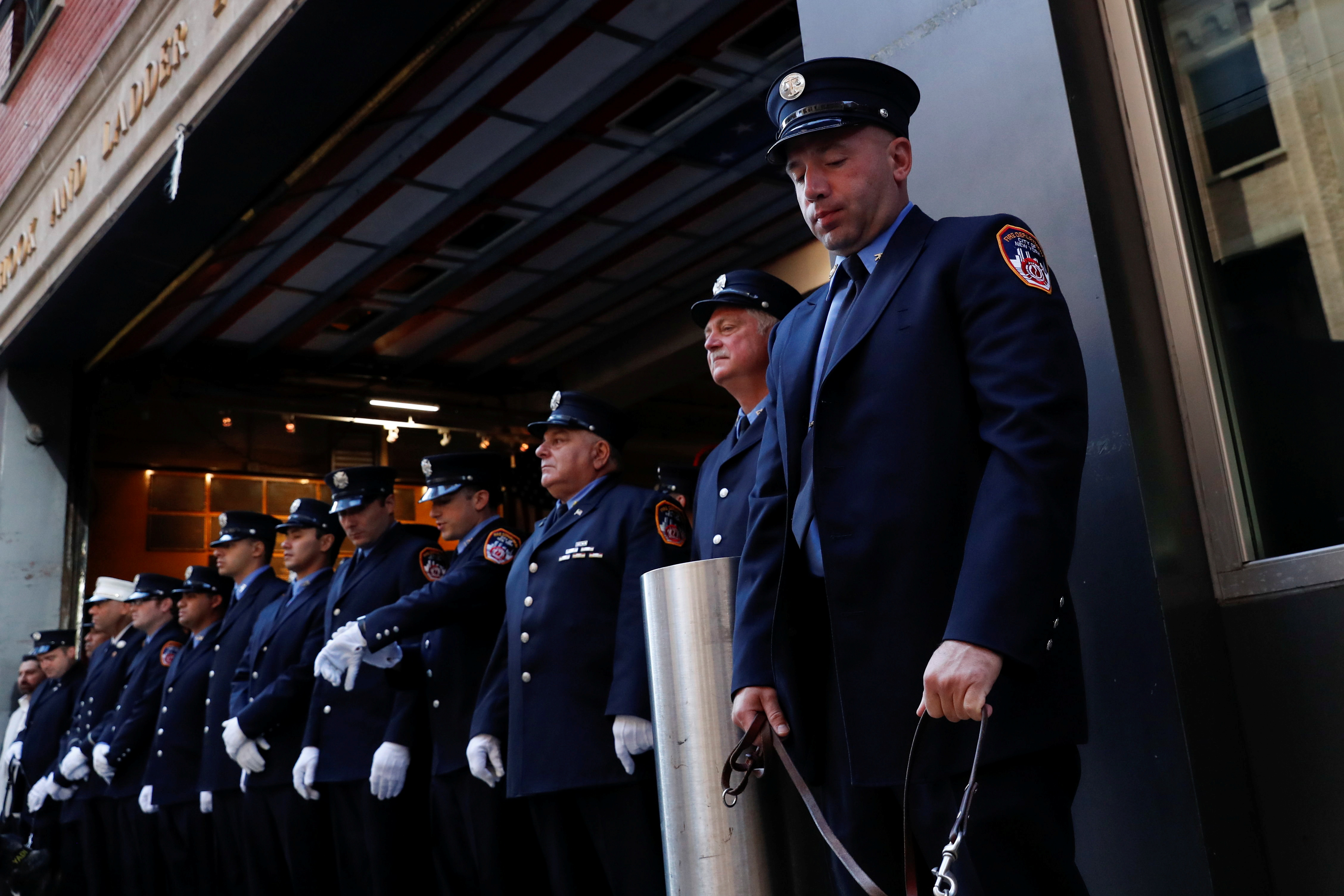 Firefighters attend a ceremony marking the 20th anniversary of the September 11, 2001 attacks, at the FDNY Engine 1/Ladder 24 fire house in New York City, New York, U.S., September 11, 2021.  REUTERS/Shannon Stapleton