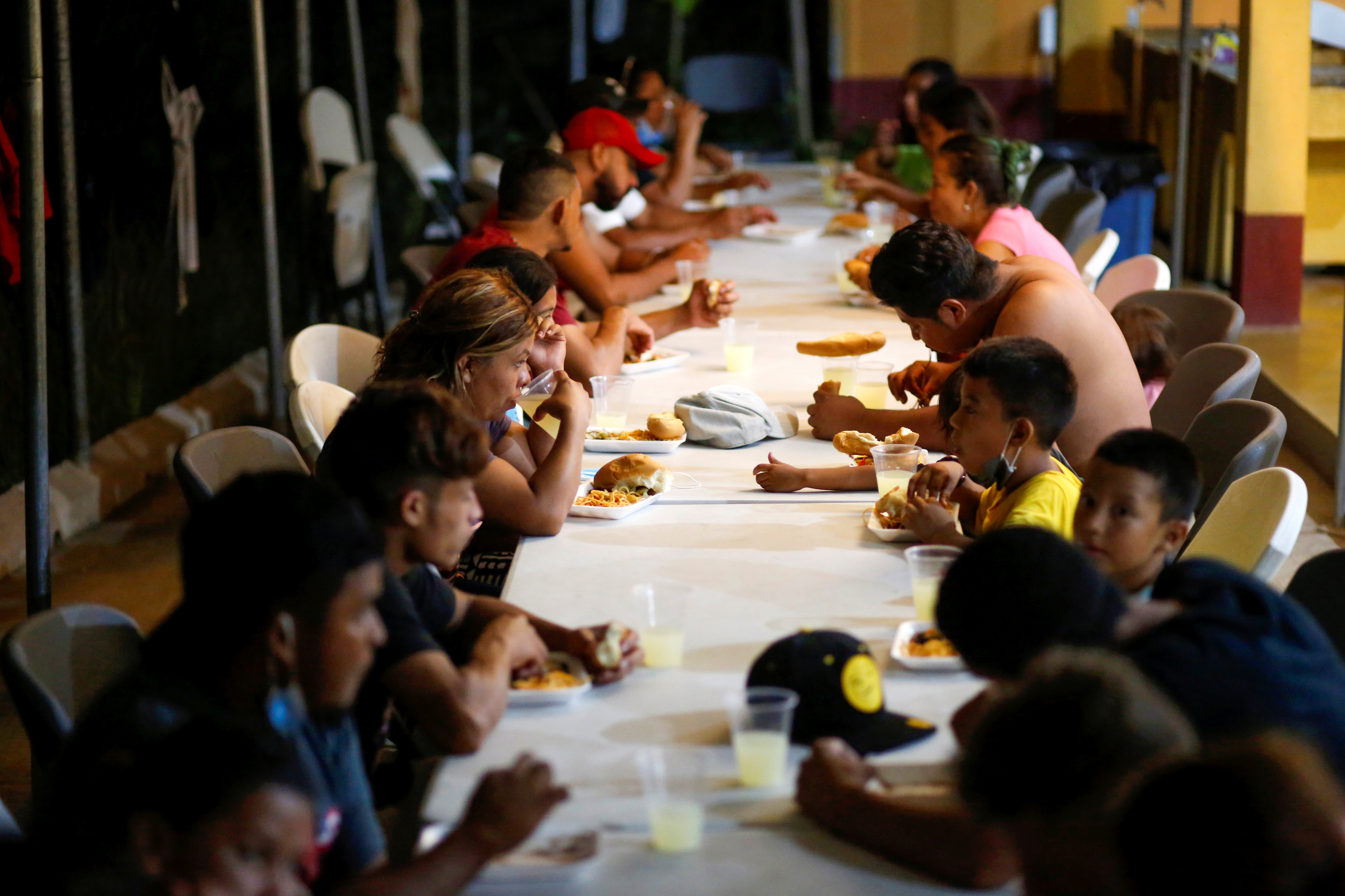 Central American migrants who were expelled by U.S. and Mexican officials, eat at a shelter, in El Ceibo, Guatemala August 15, 2021. REUTERS/Luis Echeverria