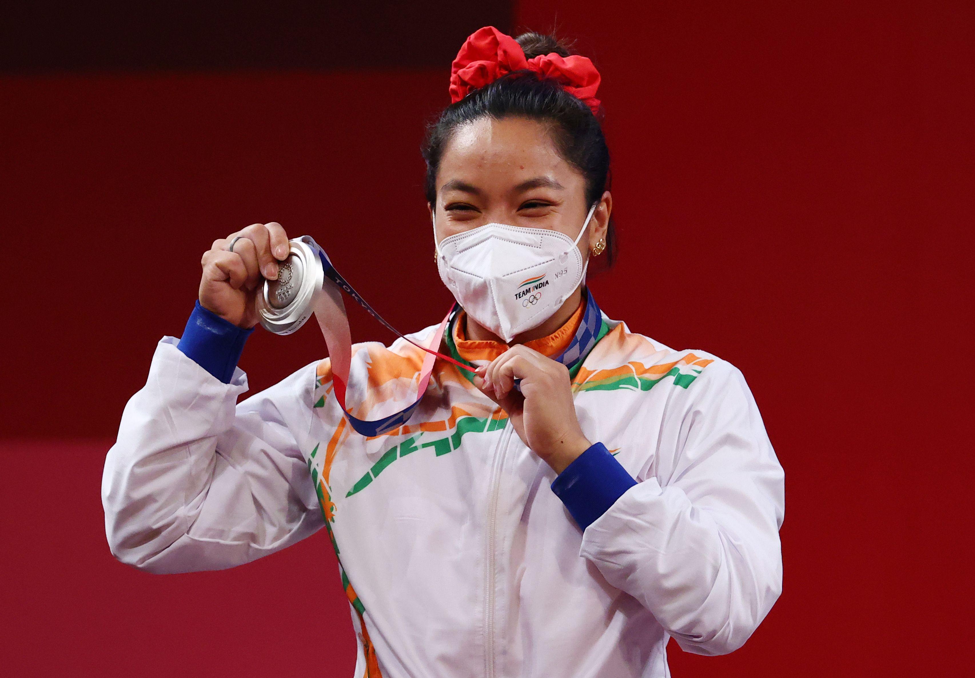 Tokyo 2020 Olympics - Weightlifting - Women's 49kg - Medal Ceremony - Tokyo International Forum, Tokyo, Japan - July 24, 2021. Silver medalist Mirabai Chanu Saikhom of India reacts. REUTERS/Edgard Garrido