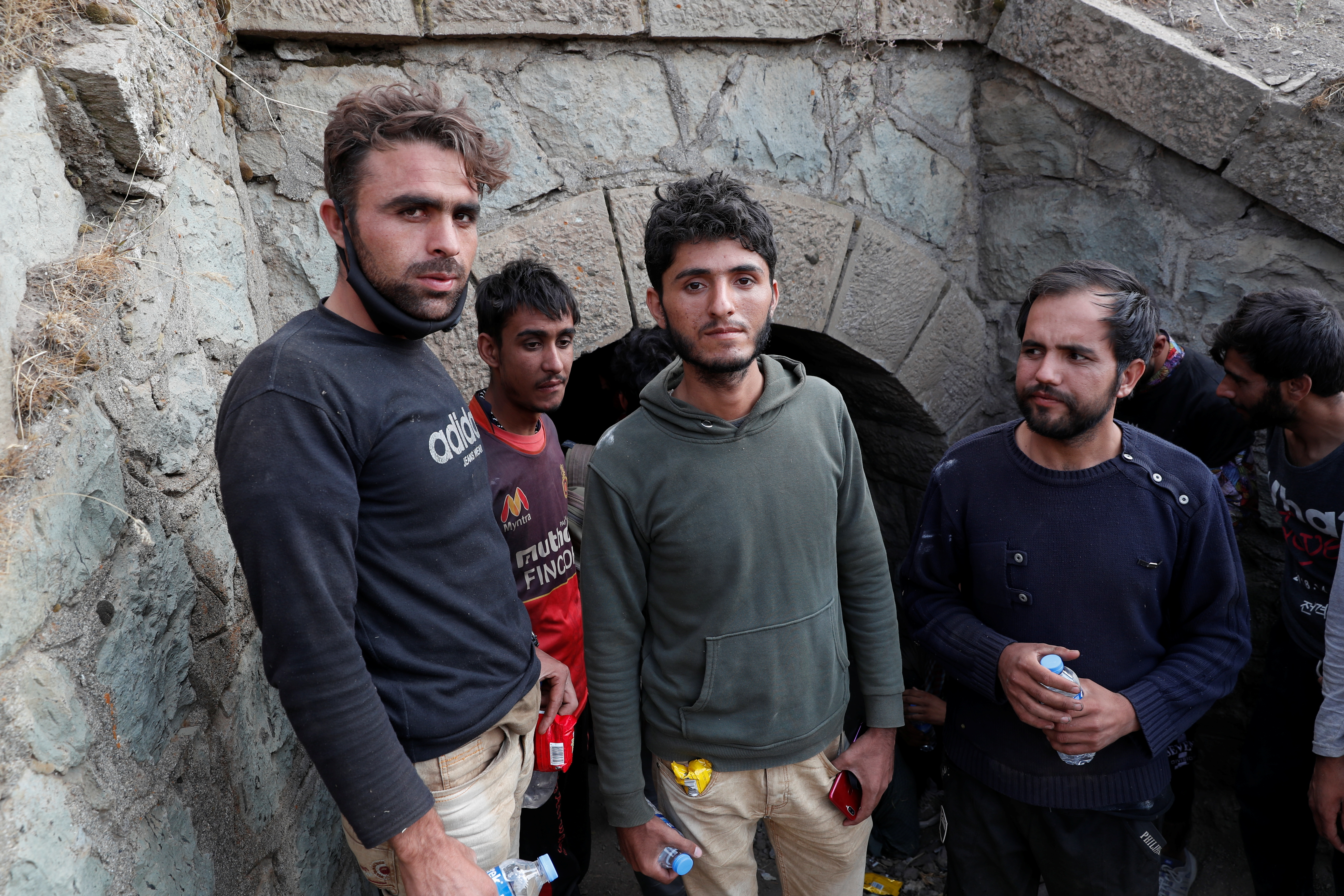 Muhammad Ali, an Afghan migrant from Khost who planned to found his own cryptocurrency mining business, center, and the other migrants hide from security forces after crossing illegally into Turkey from Iran, near Tatvan in Bitlis province, Turkey August 23, 2021. REUTERS/Murad Sezer