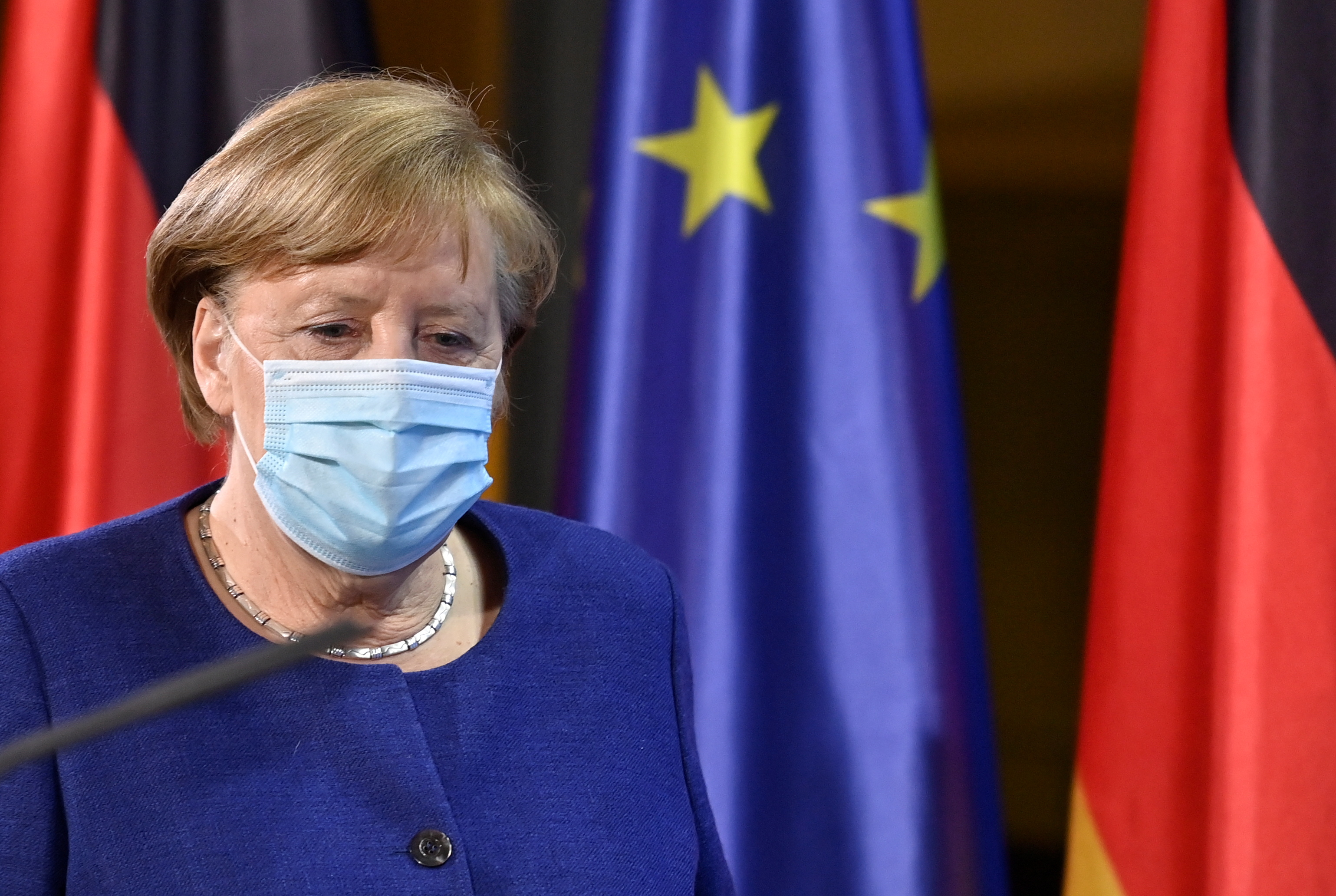 German Chancellor Angela Merkel arrives for a press conference following the EU leaders' videoconference in Berlin, Germany February 25, 2021. John MacDougall/Pool via REUTERS