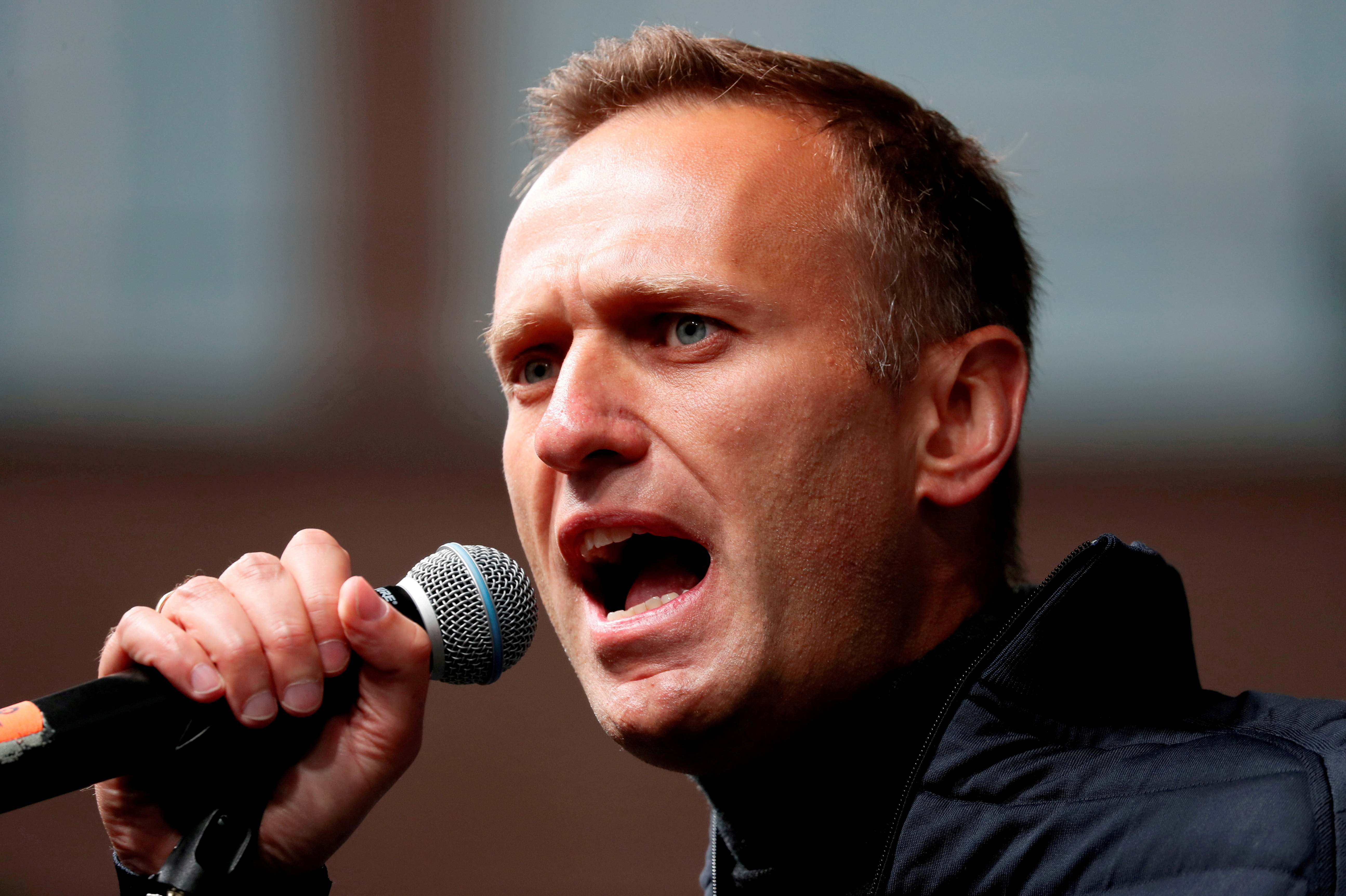 Russian opposition figure Alexei Navalny delivers a speech during a rally to demand the release of jailed protesters, who were detained during opposition demonstrations for fair elections, in Moscow, Russia September 29, 2019. REUTERS/Shamil Zhumatov/File Photo