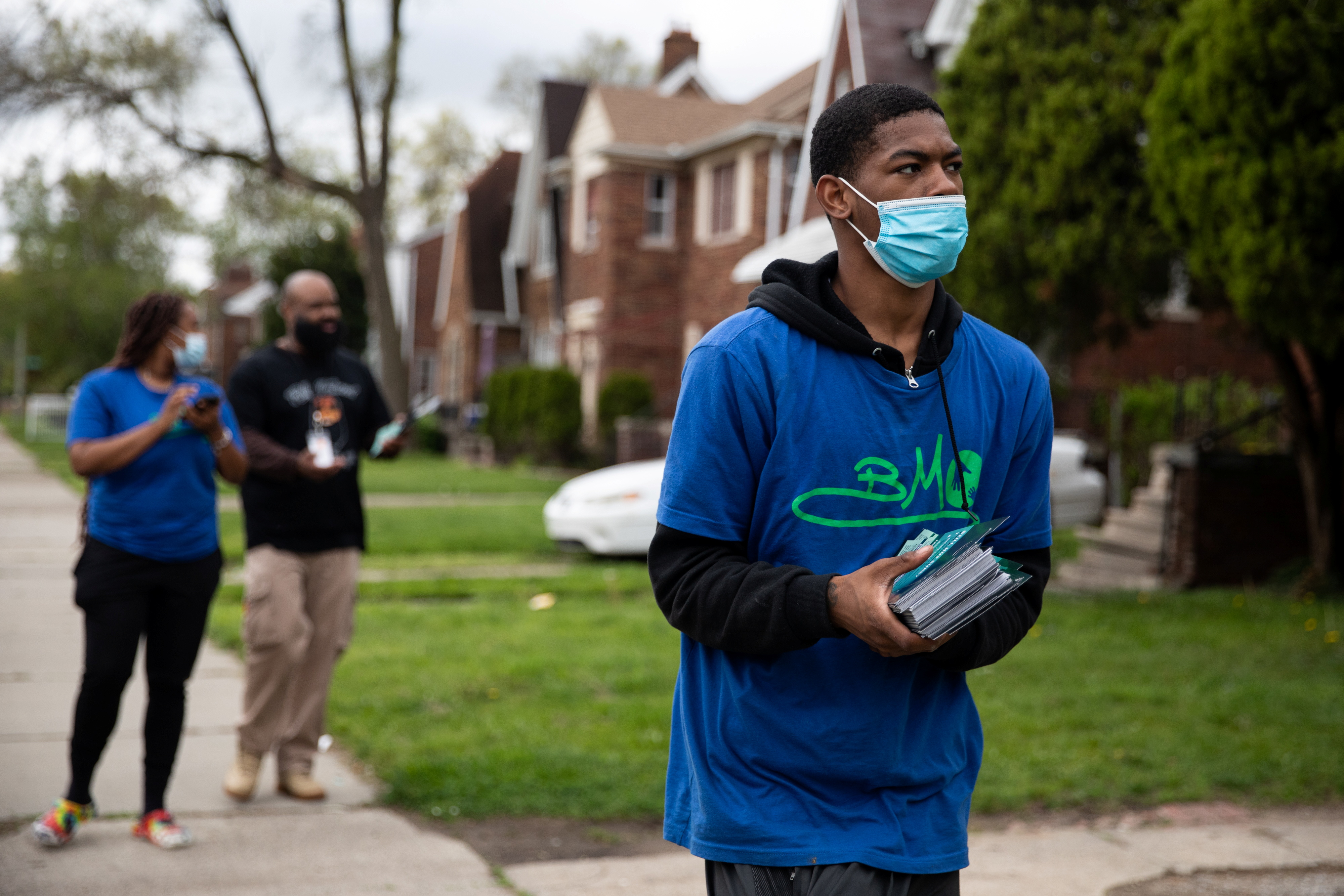 Sirgregory Allen with Better Men Outreach participates in a door-knock campaign to help answer questions related to hesitancy around the coronavirus disease (COVID-19) vaccine in Detroit, Michigan, U.S., May 4, 2021. REUTERS/Emily Elconin