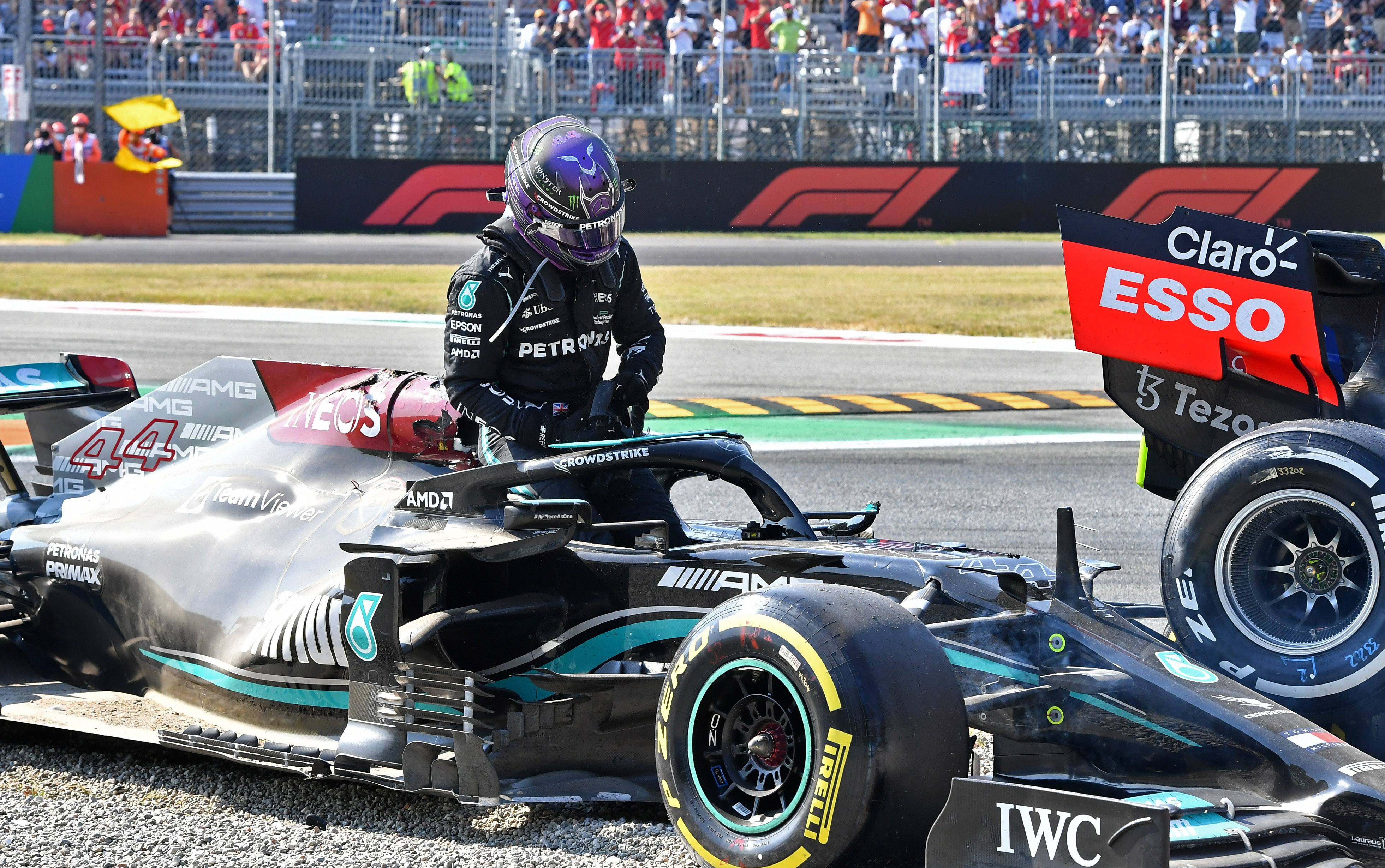 Formula One F1 - Italian Grand Prix - Autodromo Nazionale Monza, Monza, Italy - September 12, 2021 Mercedes' Lewis Hamilton after crashing out of the race with Red Bull's Max Verstappen REUTERS/Jennifer Lorenzini