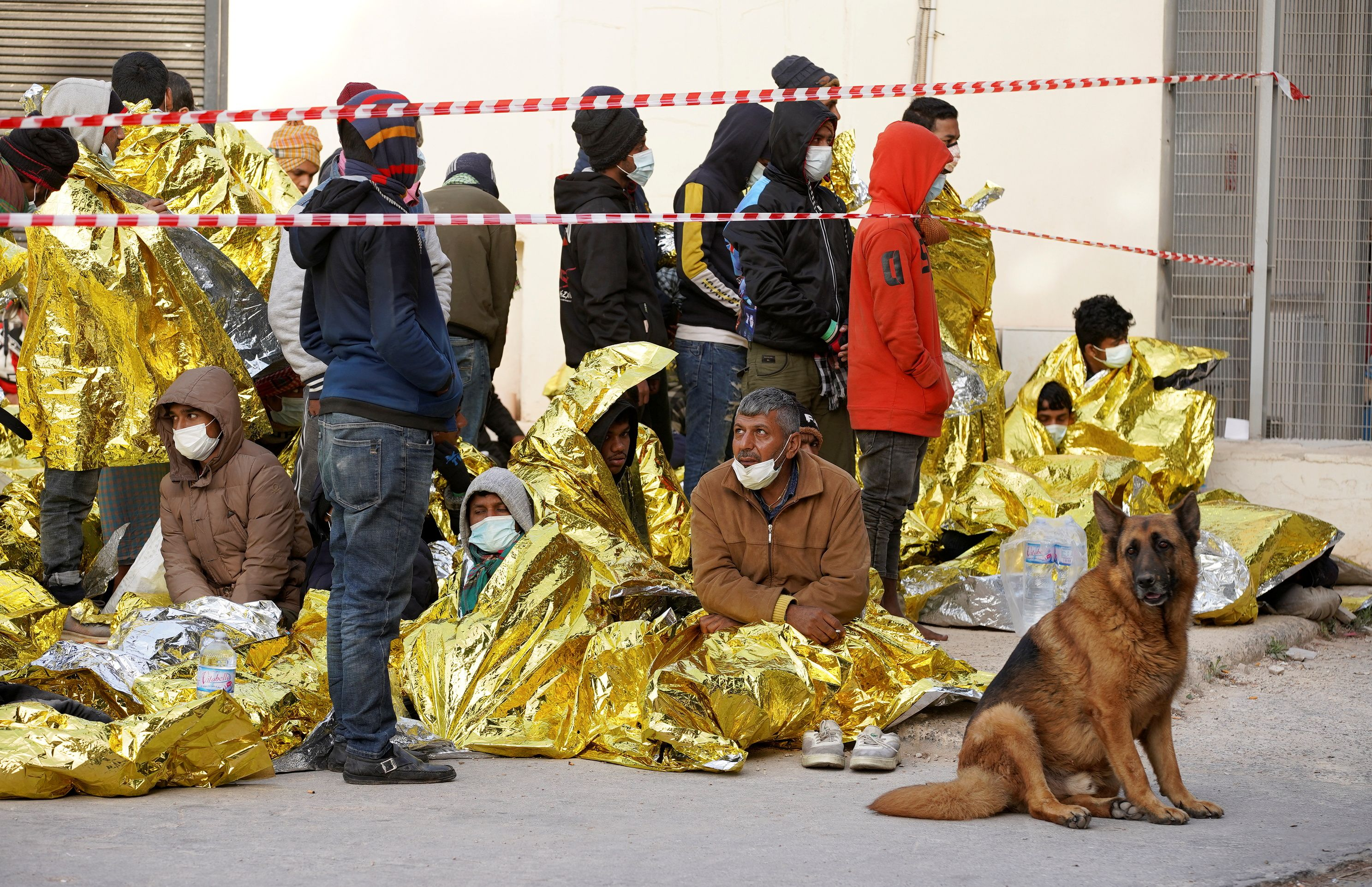Migrants rest at a reception centre after arriving on the southern island of Lampedusa, Italy May 11, 2021. REUTERS/Antonio Parrinello