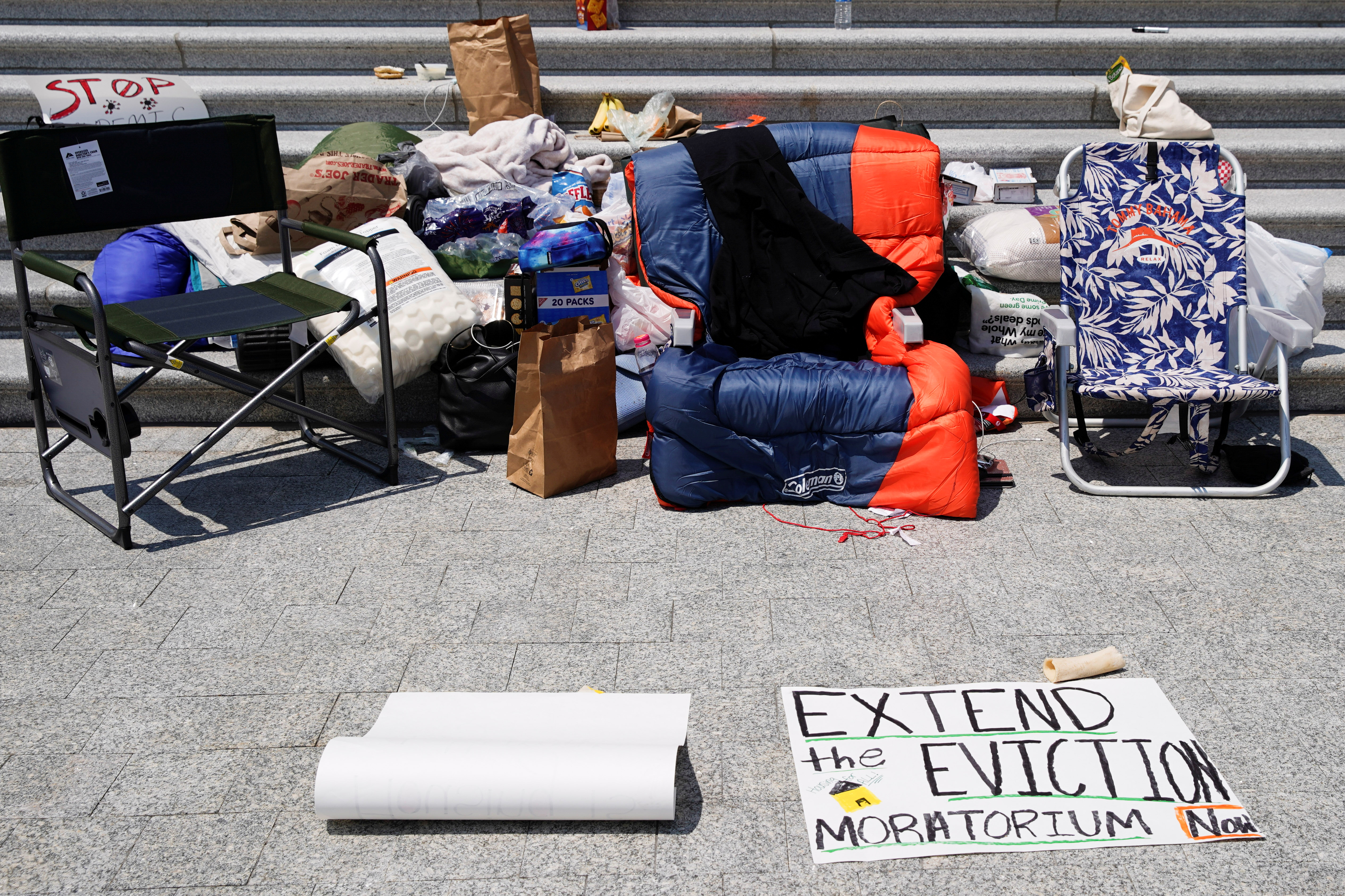 A sleeping bag is seen on the chair of U.S. Representative Cori Bush (D-MO) who spent the night on the steps of the U.S. Capitol to highlight the upcoming expiration of the pandemic-related federal moratorium on residential evictions, in Washington, U.S., July 31, 2021. REUTERS/Elizabeth Frantz