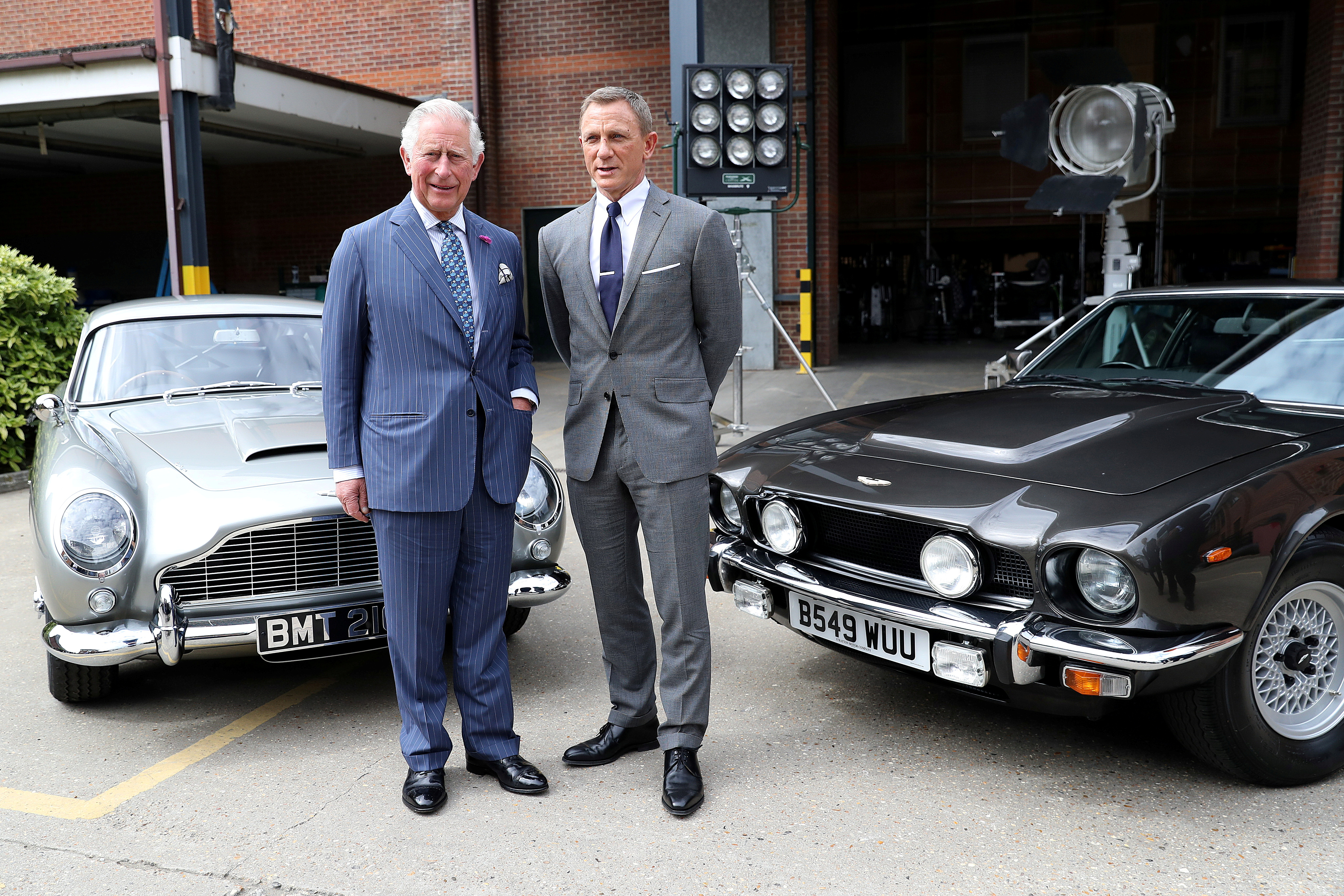 Prince Charles poses with British actor Daniel Craig as he tours the set of the 25th James Bond Film at Pinewood Studios in Iver Heath, Buckinghamshire, Britain June 20, 2019. Chris Jackson/Pool via REUTERS/File Photo