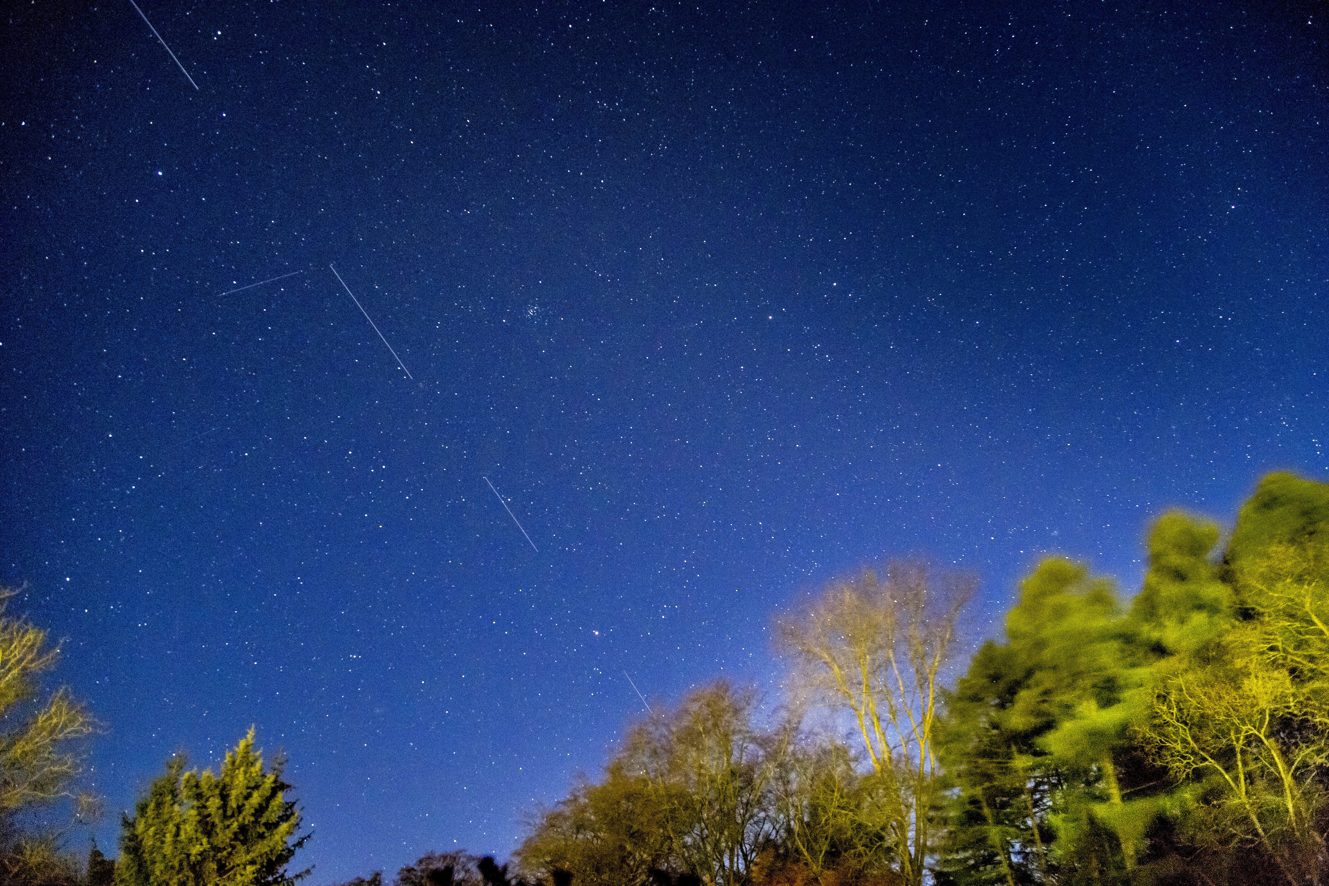 SpaceX Starlink 5 satellites are pictured in the sky seen from Svendborg on South Funen, Denmark April 21, 2020. Picture taken with long exposure. Ritzau Scanpix/Mads Claus Rasmussen via REUTERS