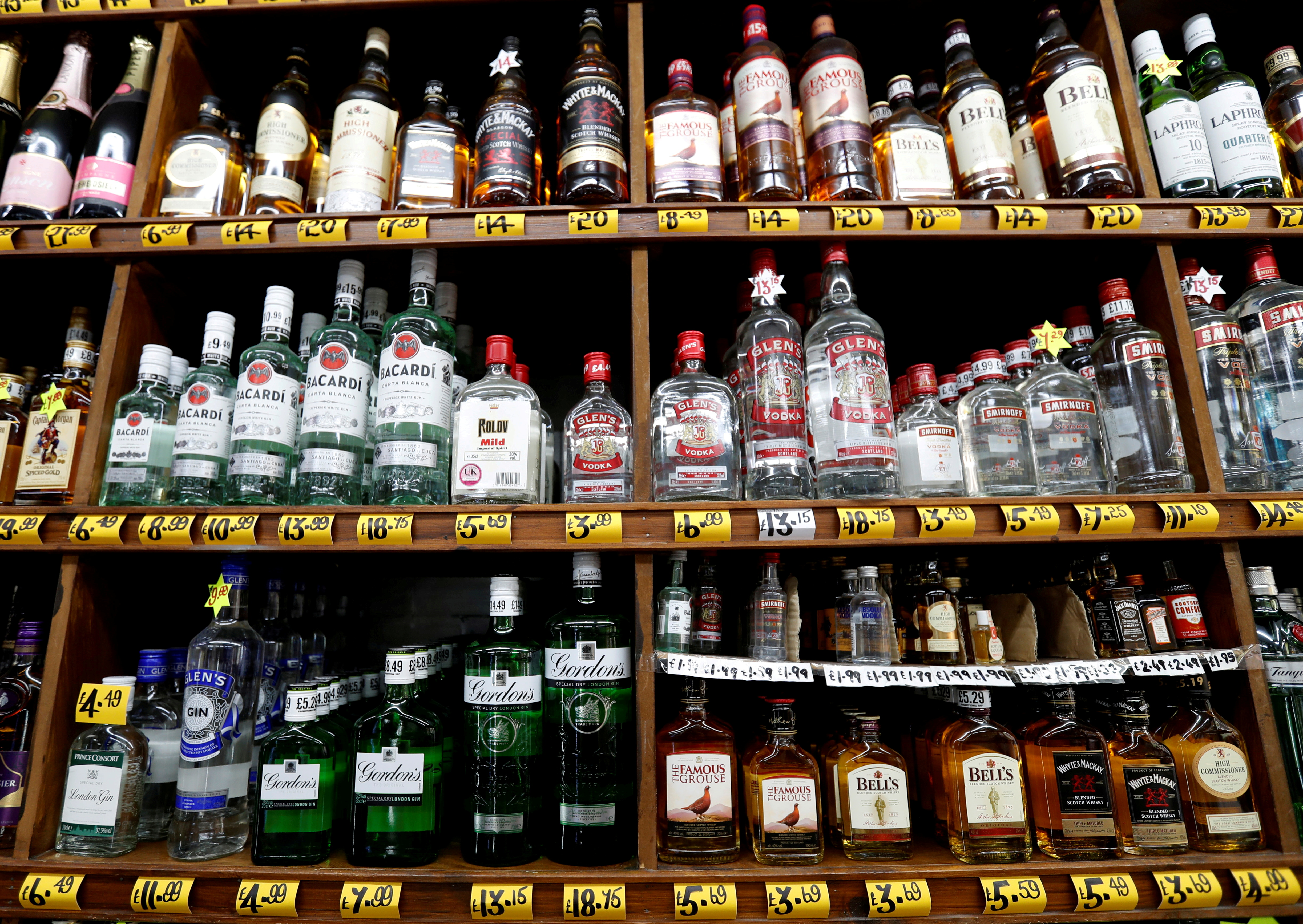 Bottles of alcoholic beverages are seen for sale in a shop in Glasgow, Scotland, Britain, May 1, 2018. REUTERS/Russell Cheyne/File Photo