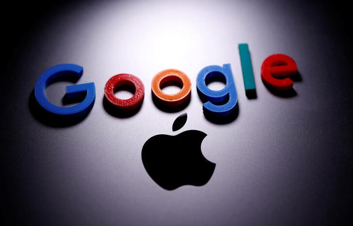 A 3D printed Google logo is placed on the Apple Macbook in this illustration taken April 12, 2020. REUTERS/Dado Ruvic/Illustration
