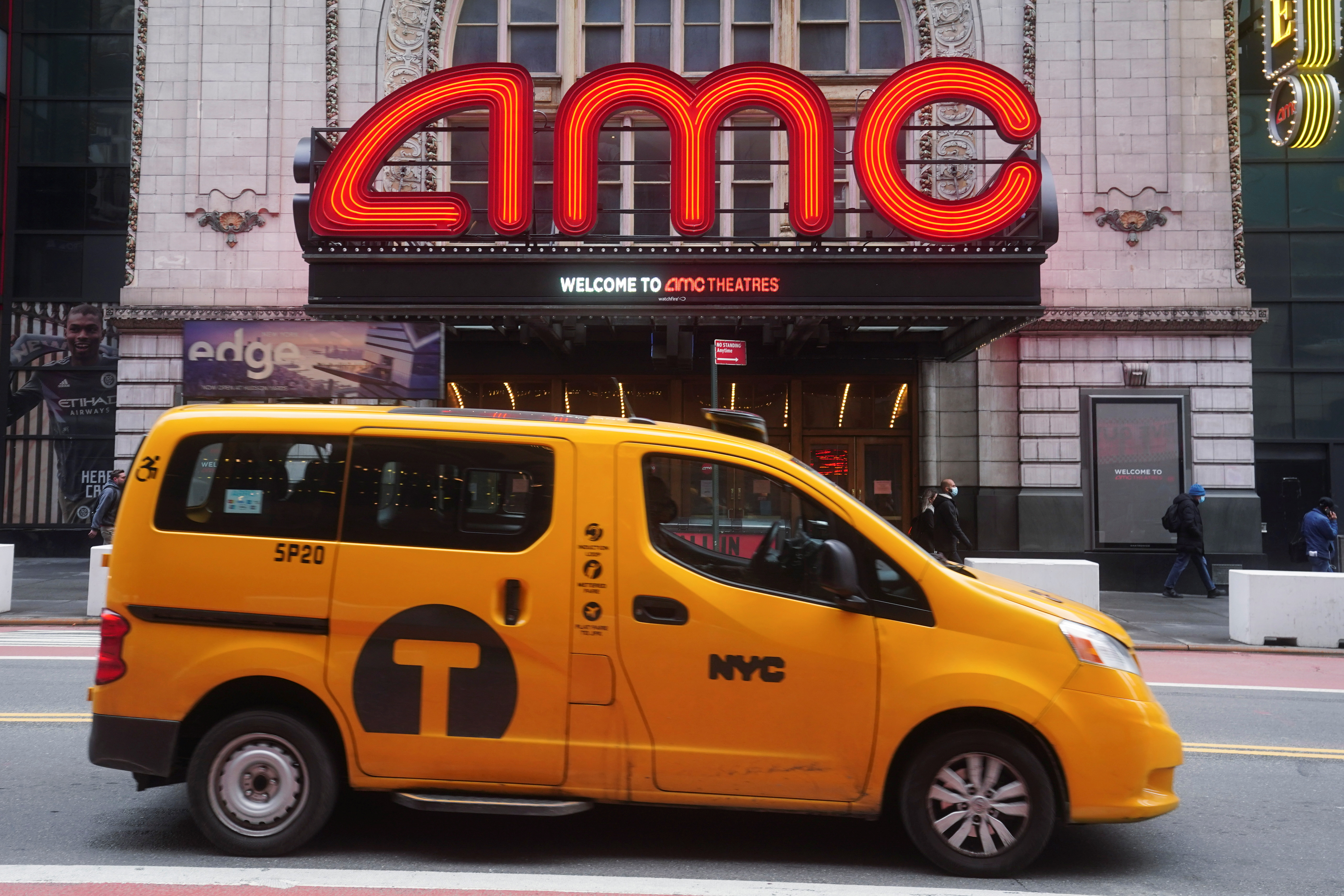 A taxi passes an AMC theatre amid the coronavirus disease (COVID-19) pandemic in the Manhattan borough of New York City, New York, U.S., January 27, 2021. REUTERS/Carlo Allegri