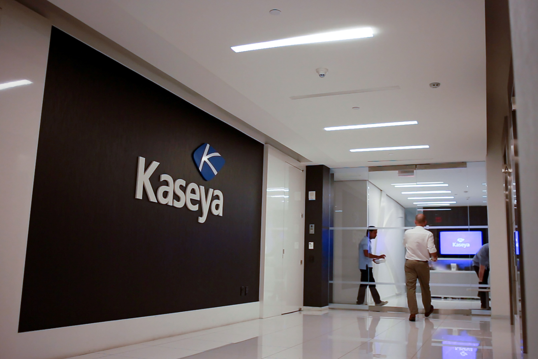 Staff enter the headquarters of information technology firm Kaseya in Miami, Florida, U.S., in an undated still image from video. Kaseya/Handout via REUTERS