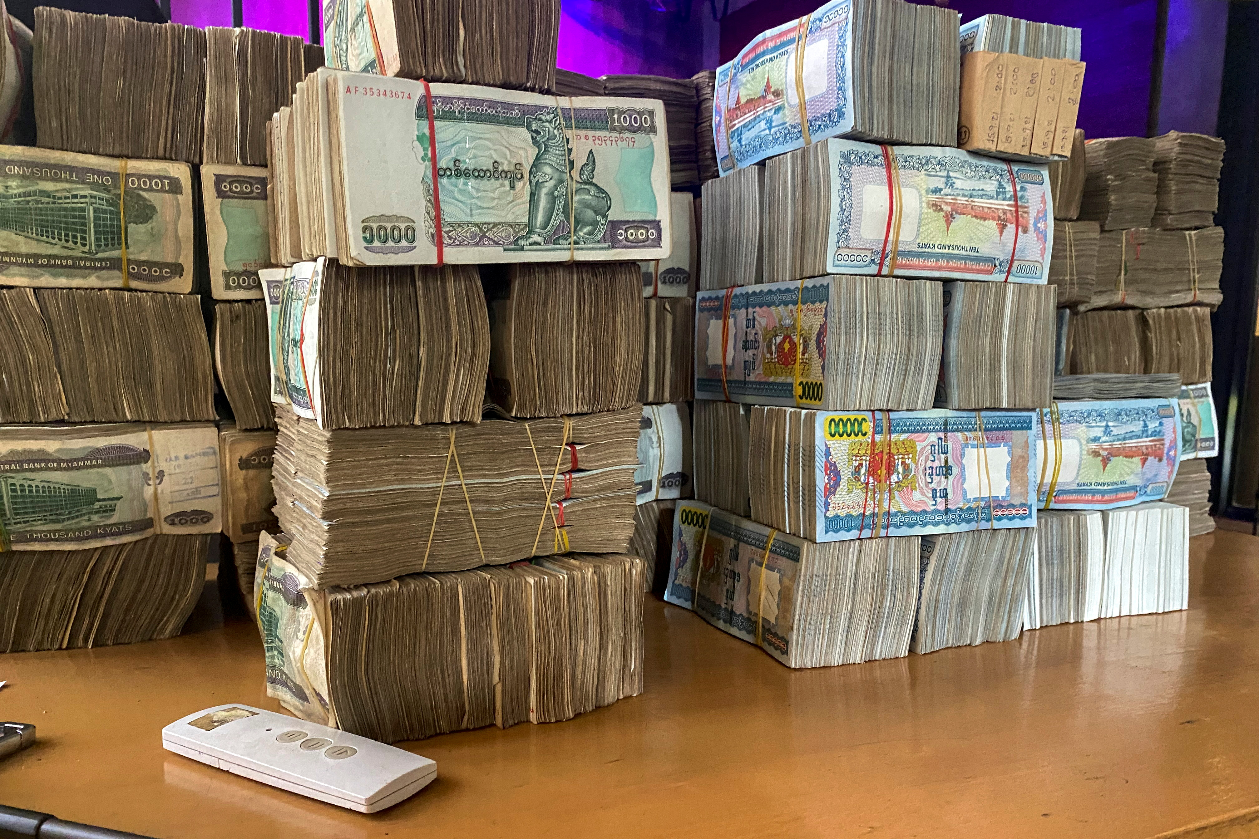 Myanmar banknotes are seen during an illegal exchange inside a house in Yangon, Myanmar, September 24, 2021. Picture taken September 24, 2021. REUTERS/Stringer