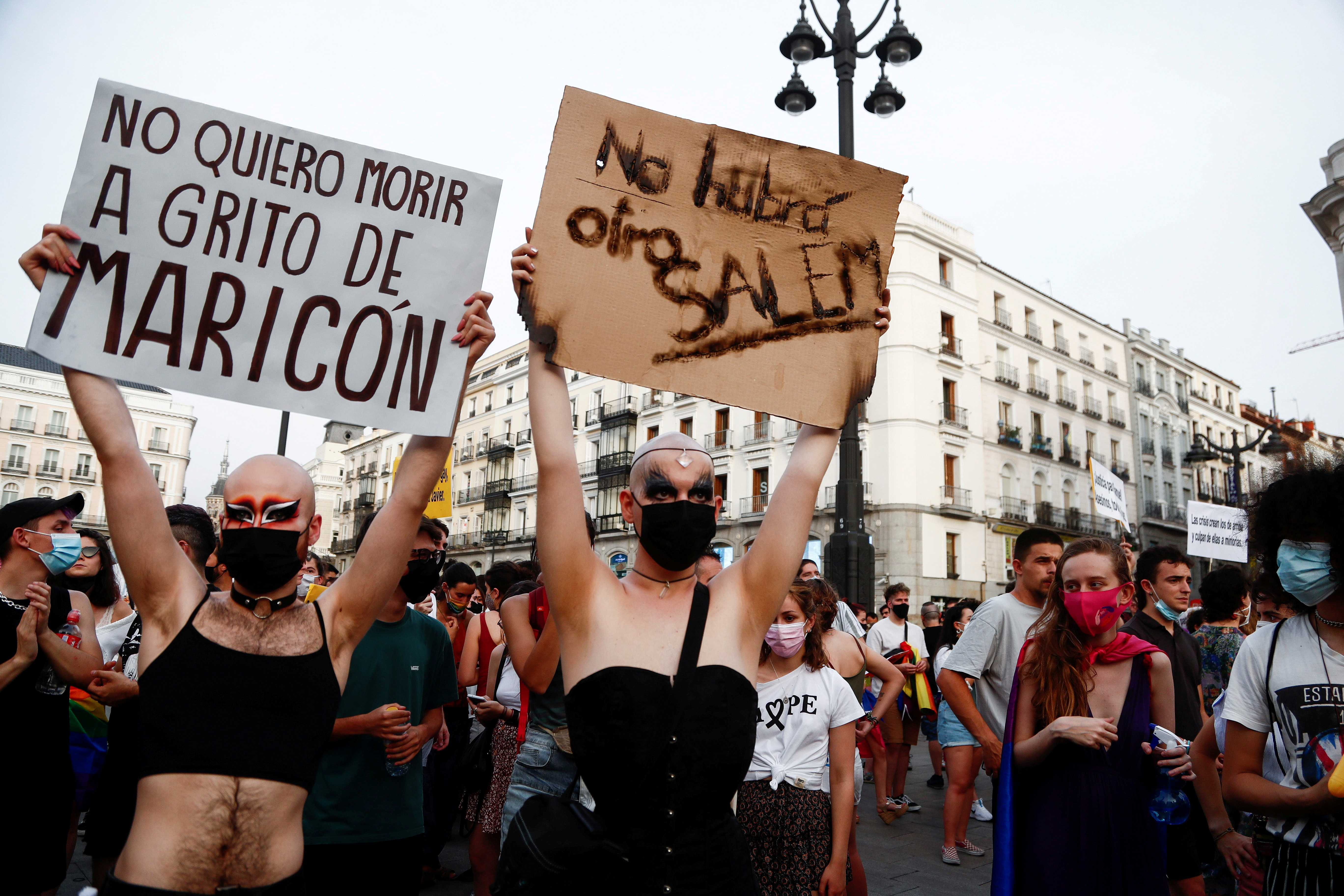 LGBT activists protest against homophobic crimes in Madrid, Spain, July 11, 2021. The signs read