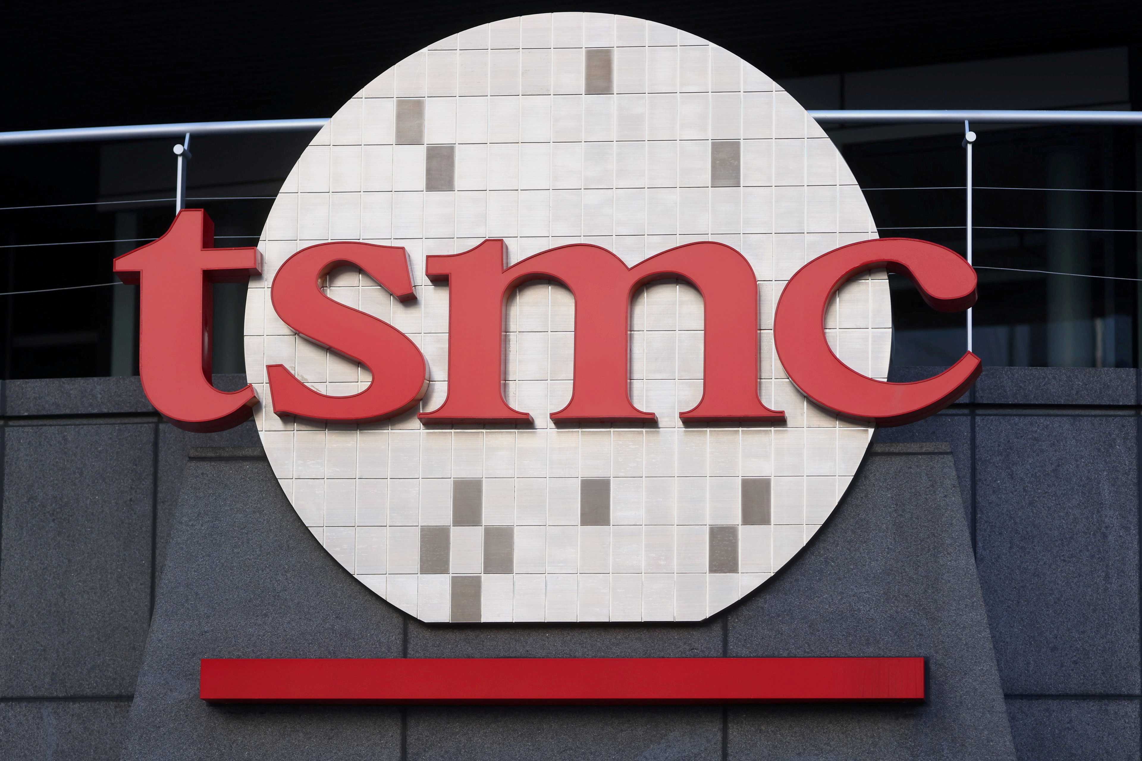 The logo of Taiwan Semiconductor Manufacturing Co (TSMC) is pictured at its headquarters, in Hsinchu, Taiwan, January 19, 2021. REUTERS/Ann Wang/File Photo