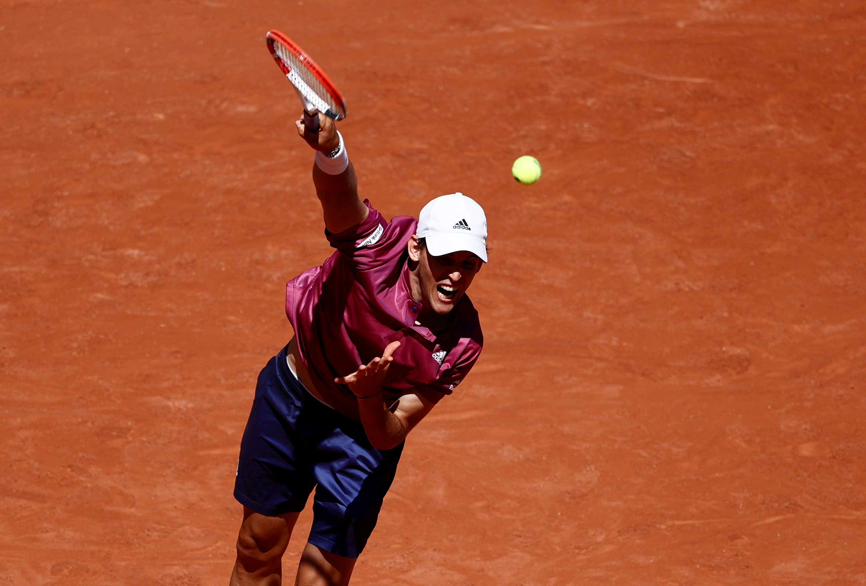 Tennis - French Open - Roland Garros, Paris, France - May 30, 2021 Austria's Dominic Thiem reacts in action during his first round match against Spain's Pablo Andujar REUTERS/Christian Hartmann
