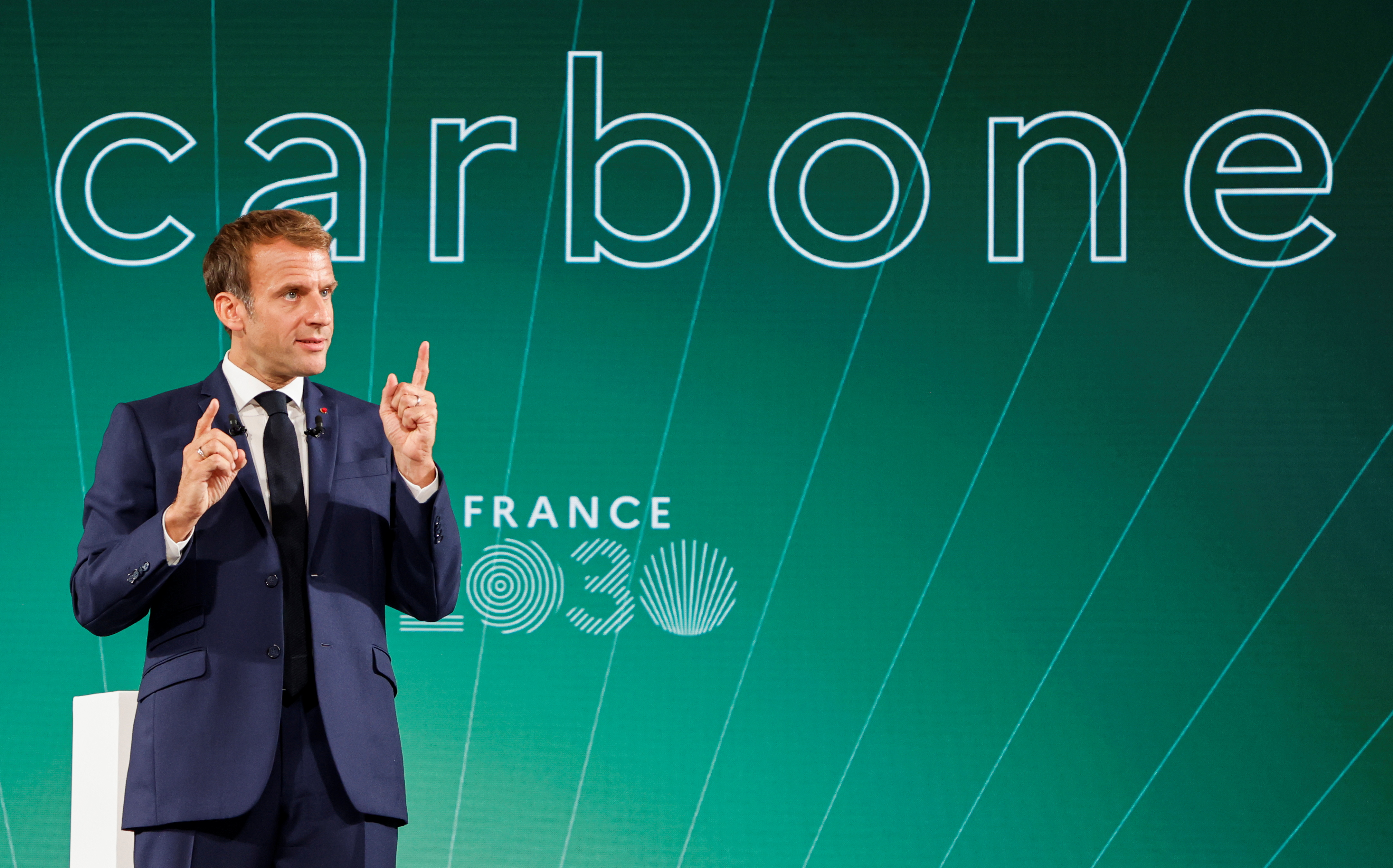 French President Emmanuel Macron gestures as he speaks during the presentation of the