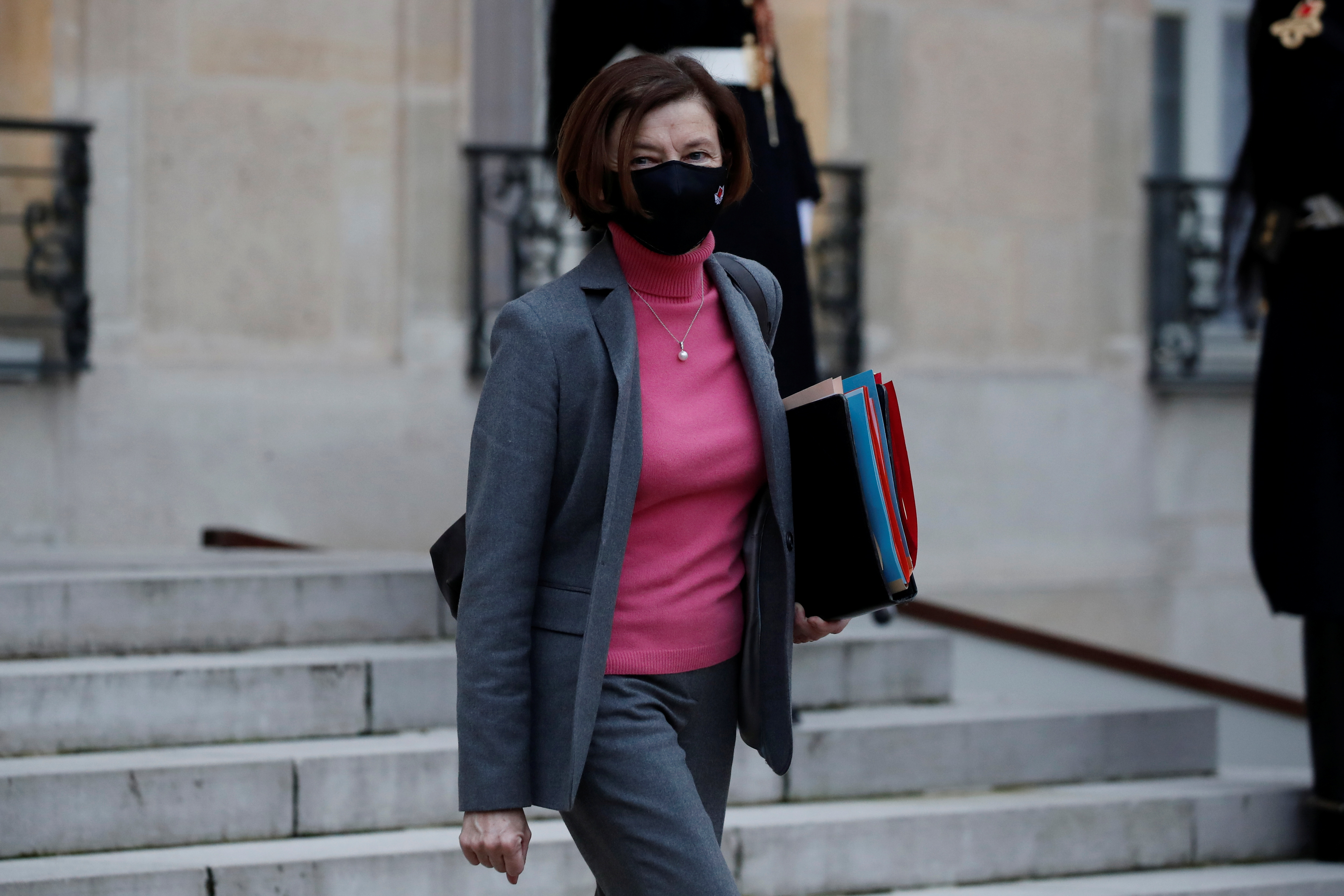 French Defence Minister Florence Parly, wearing a protective face mask, leaves following the weekly cabinet meeting at the Elysee Palace in Paris, France, January 6, 2021. REUTERS/Benoit Tessier
