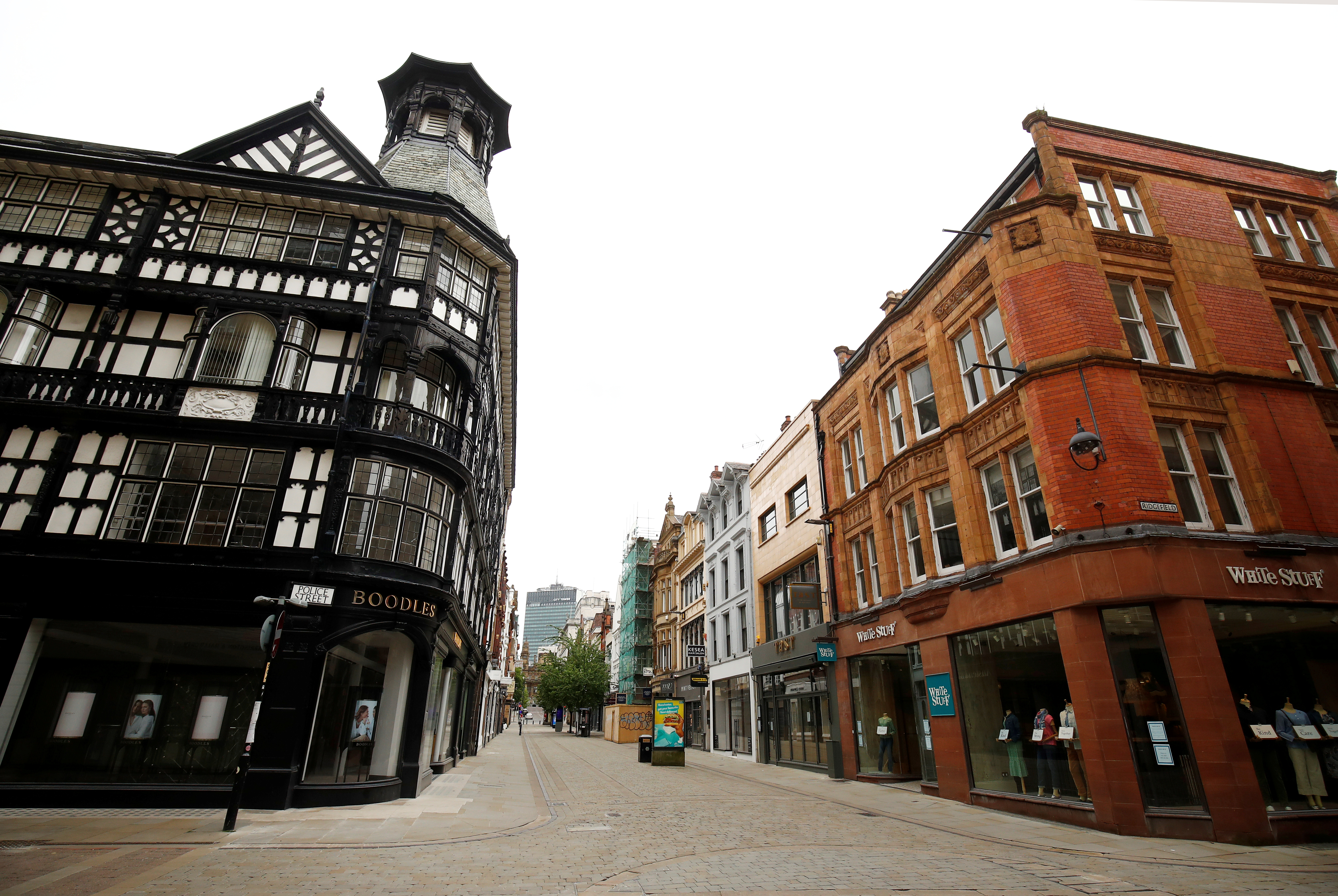 Shops closed on a deserted street in Manchester, following the outbreak of the coronavirus disease (COVID-19), Manchester, Britain, May 26, 2020. REUTERS/Jason Cairnduff/File Photo