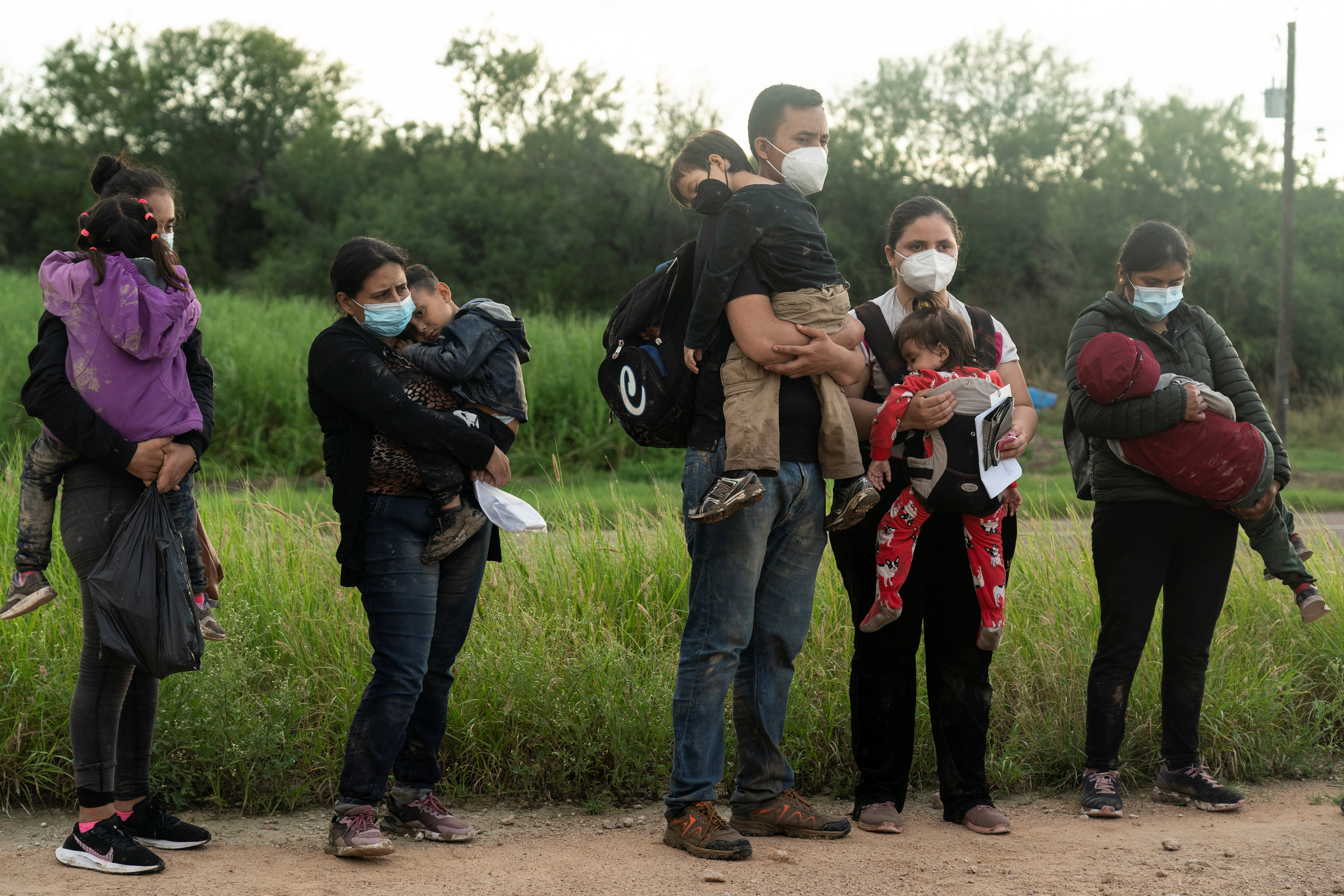 Asylum-seeking migrants' families from Central America wait to be processed by the U.S. Border Patrol agents after crossing the Rio Grande river into the United States from Mexico, in Penitas, Texas, U.S., July 8, 2021. REUTERS/Go Nakamura