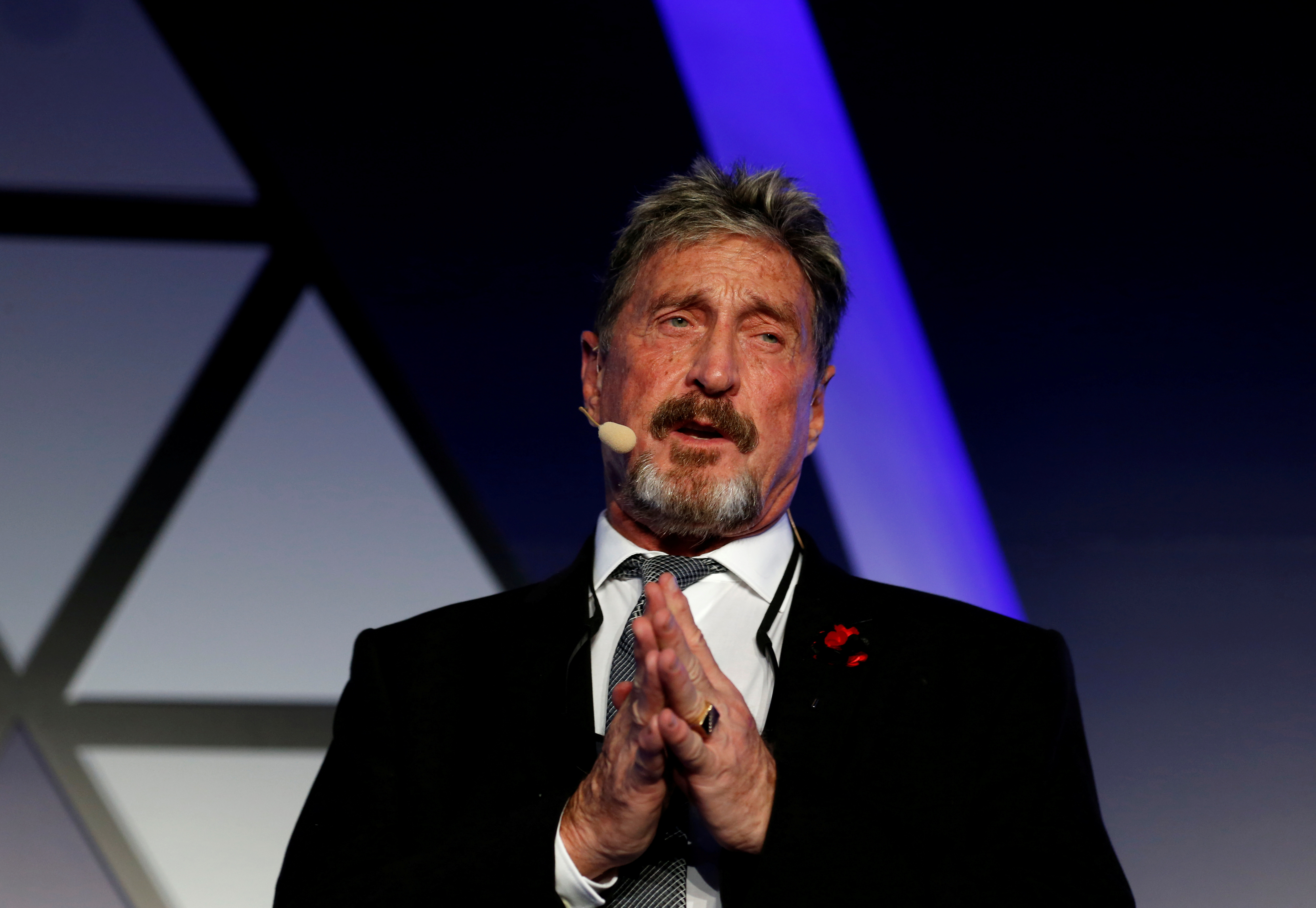 File photo: John McAfee, co-founder of McAfee Crypto Team and CEO of Luxcore and founder of McAfee Antivirus, speaks at the Malta Blockchain Summit in St Julian's, Malta. REUTERS/Darrin Zammit Lupi
