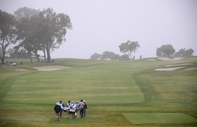 Jun 17, 2021; San Diego, California, USA; Greyson Sigg , Sahith Theegala and Edoardo Molinari walk down the first fairway after the start of the first round of the U.S. Open golf tournament at Torrey Pines Golf Course. Mandatory Credit: Orlando Ramirez-USA TODAY Sports