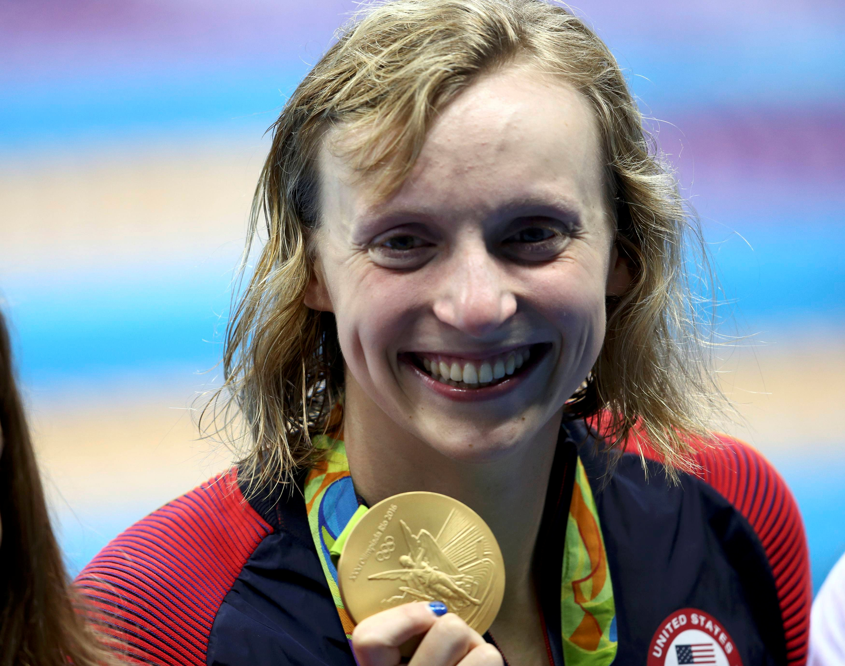 2016 Rio Olympics - Swimming - Katie Ledecky (USA) poses with her Olympic 800m freestyle gold medal - Olympic Aquatics Stadium - Rio de Janeiro, Brazil - 12/08/2016.    REUTERS/Marcos Brindicci /File Photo