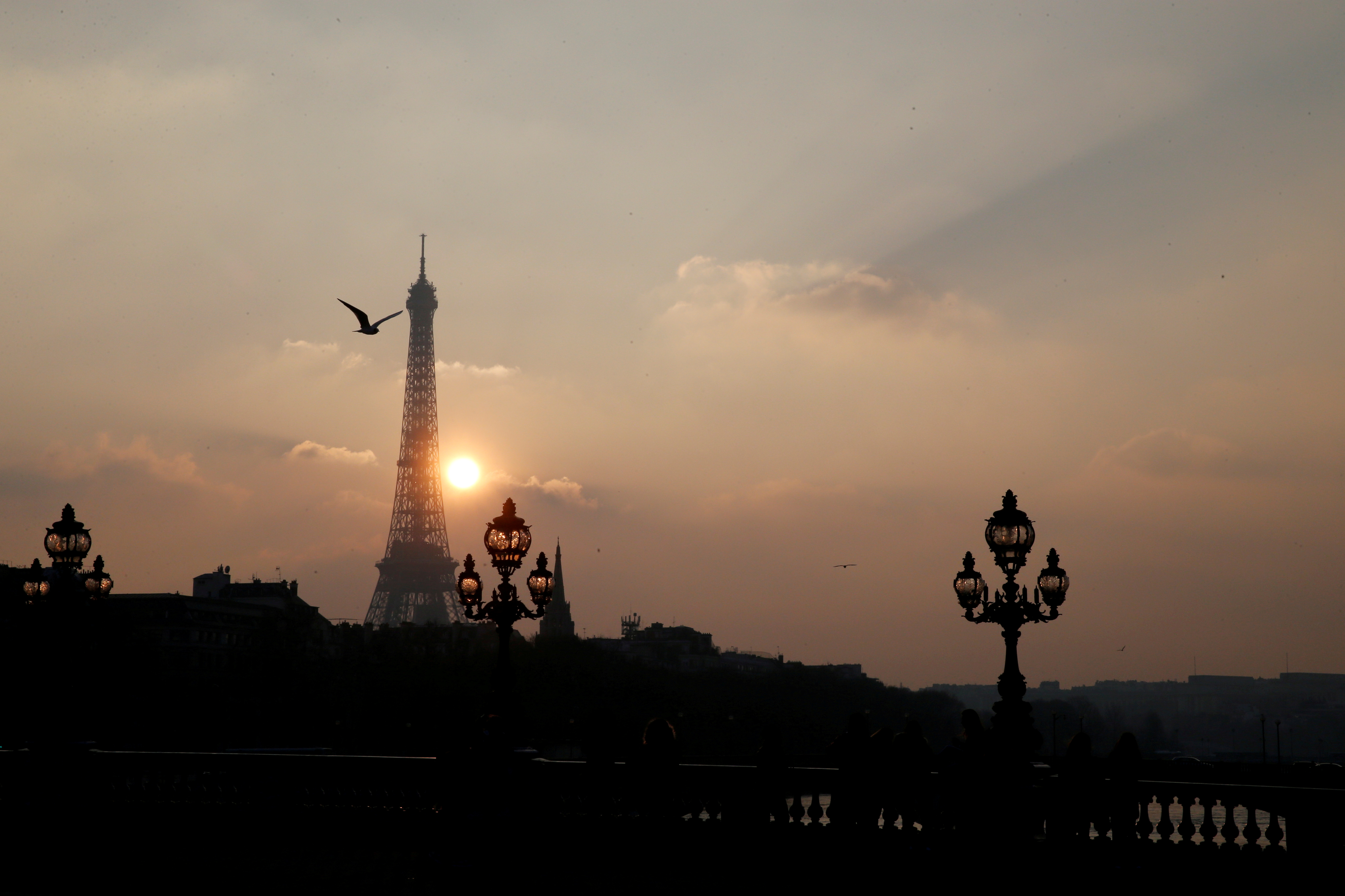 The Eiffel tower is pictured as the sun sets on a winter day in Paris, France, February 21, 2018. REUTERS/Pascal Rossignol/File Photo