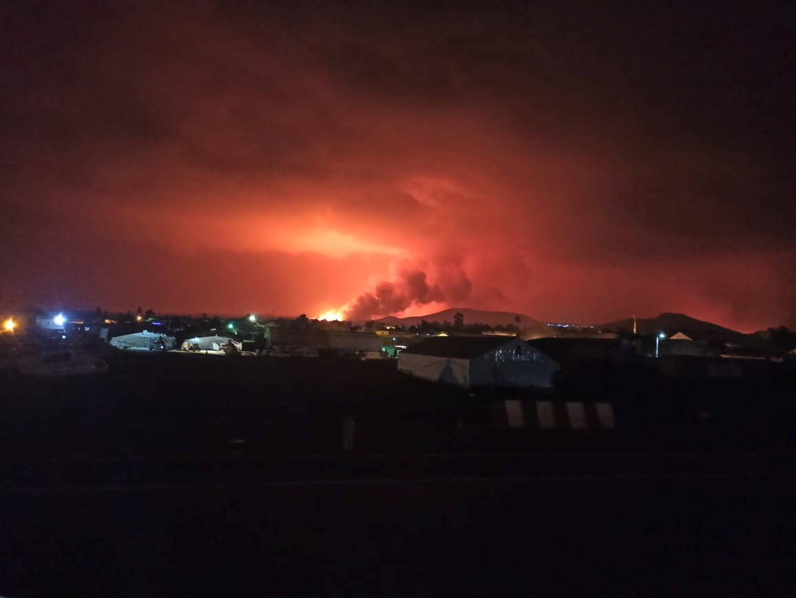 A general view from the Goma International Airport shows smoke and flames at the volcanic eruption of Mount Nyiragongo near Goma, in the Democratic Republic of Congo May 22, 2021. Picture taken May 22, 2021. The United Nations Organization Stabilization Mission in the Democratic Republic of the Congo/Handout via REUTERS