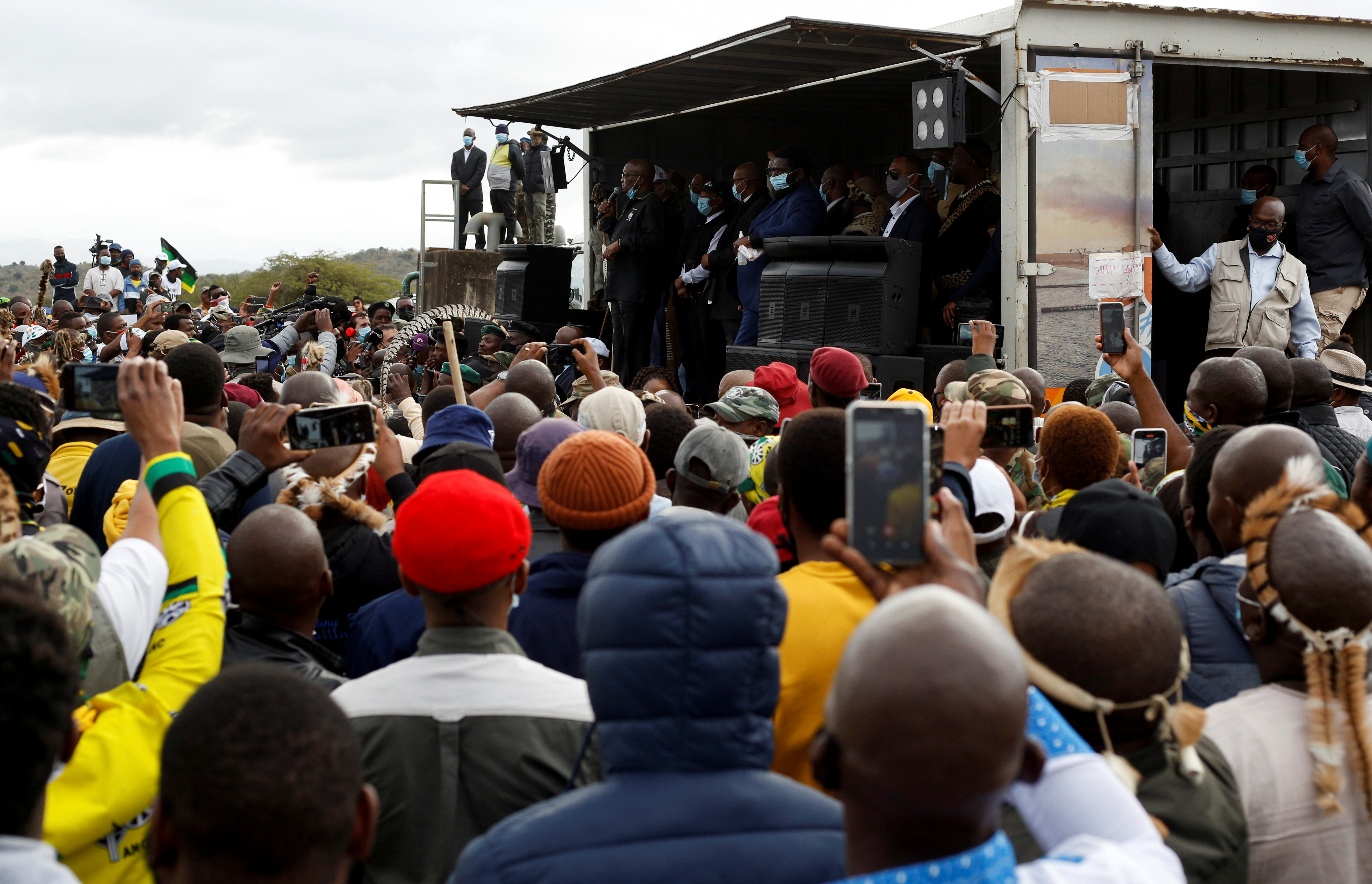 Former South African president Jacob Zuma speaks to supporters who gathered at his home, as South African court agreed to hear his challenge to a 15-month jail term for failing to attend a corruption hearing, in Nkandla, South Africa, July 4, 2021. REUTERS/Rogan Ward