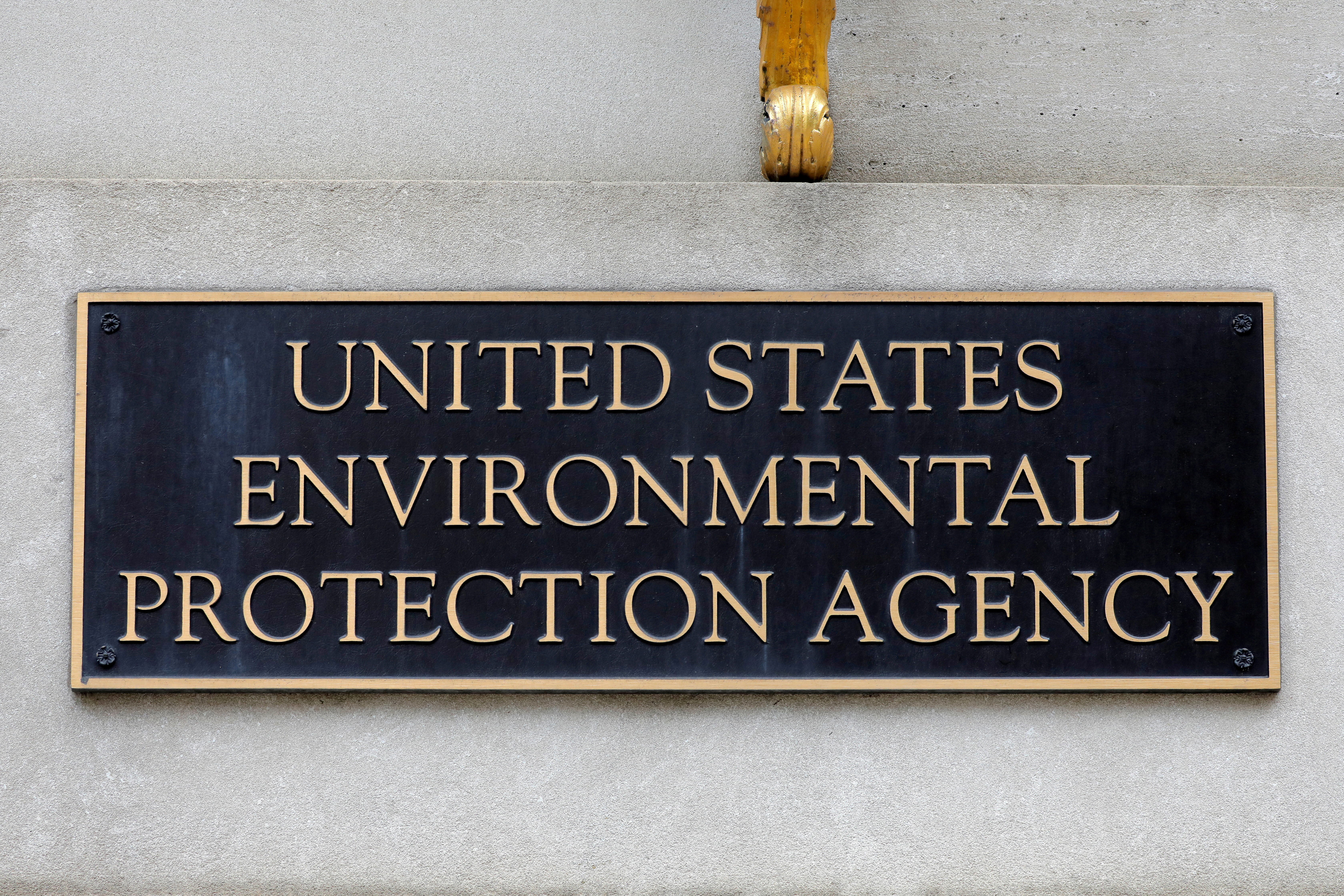 Signage is seen at the headquarters of the United States Environmental Protection Agency (EPA) in Washington, D.C., U.S., May 10, 2021. REUTERS/Andrew Kelly/File Photo