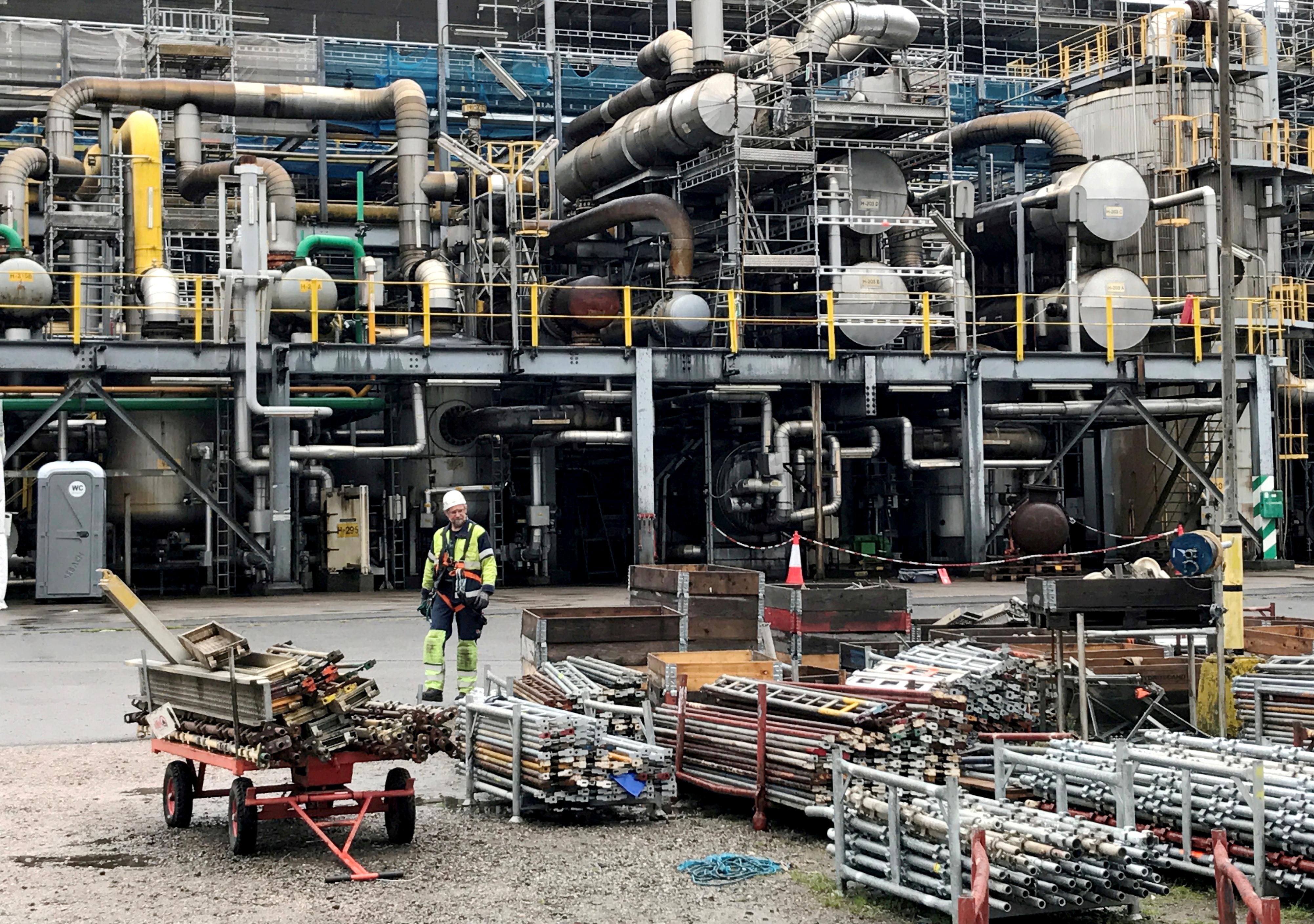 A worker walks at the Yara ammonia plant in Porsgrunn, Norway August 9, 2017. REUTERS/Lefteris Karagiannopoulos