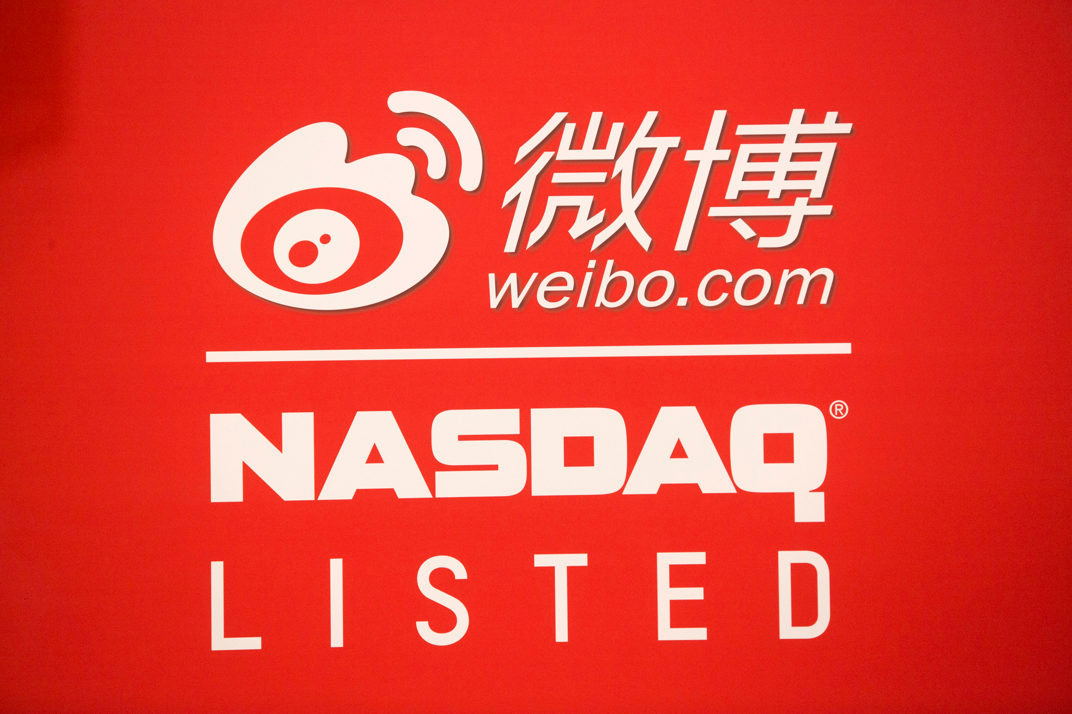 Signage for Weibo Corporation is seen at the NASDAQ MarketSite in Times Square on day one of its initial public offering (IPO) on The NASDAQ Stock Market in New York  April 17, 2014. REUTERS/Andrew Kelly/File Photo